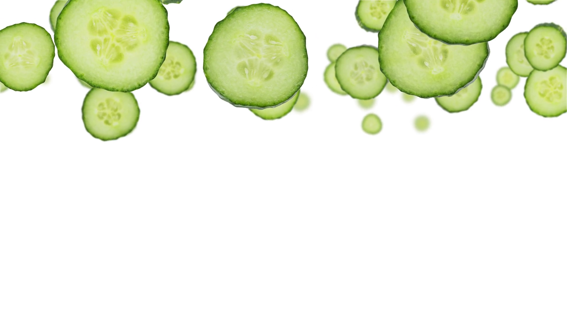 Cucumber slices falling down on white background (vertical, not ...