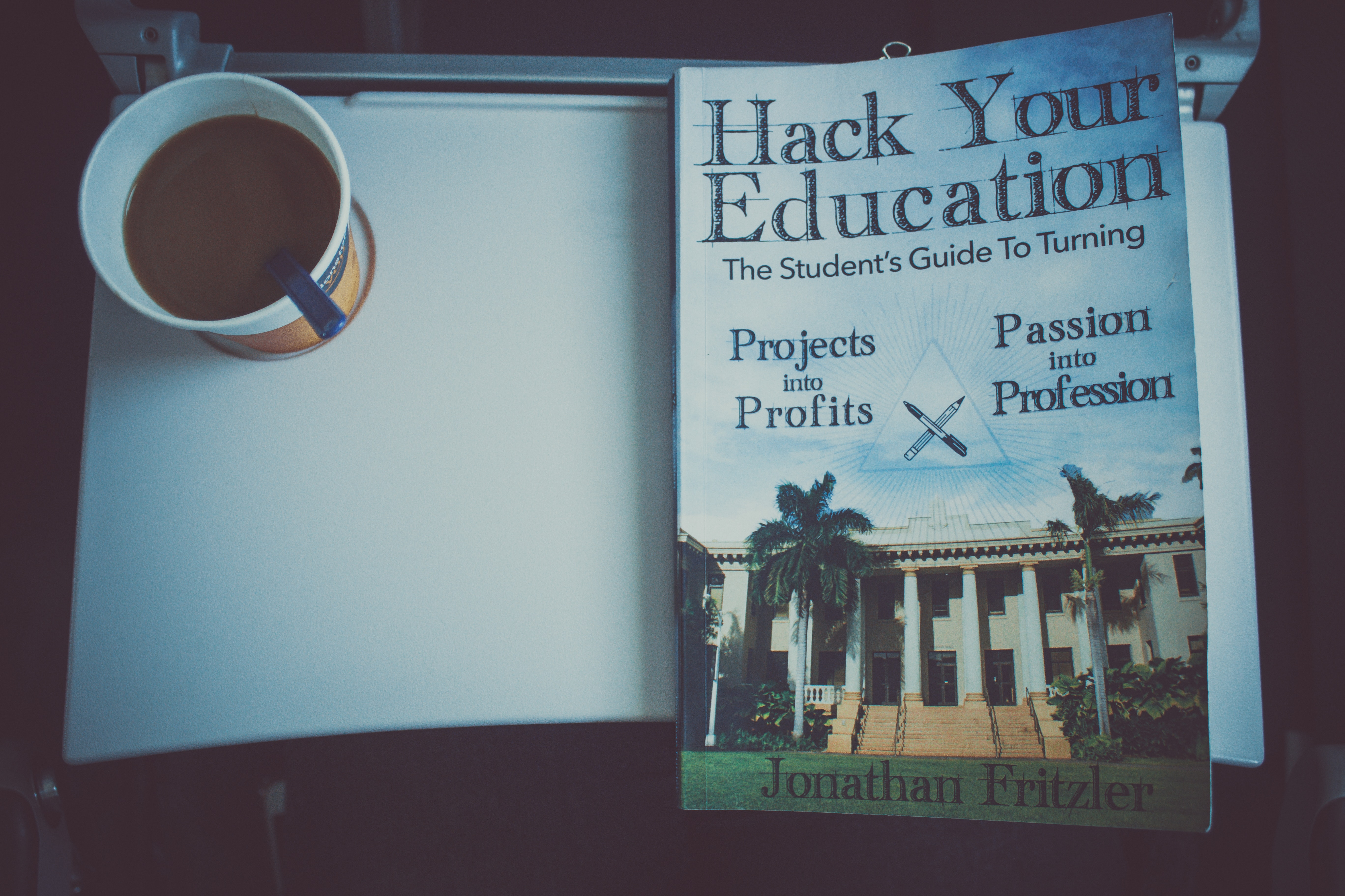 Cup of coffee and a book photo