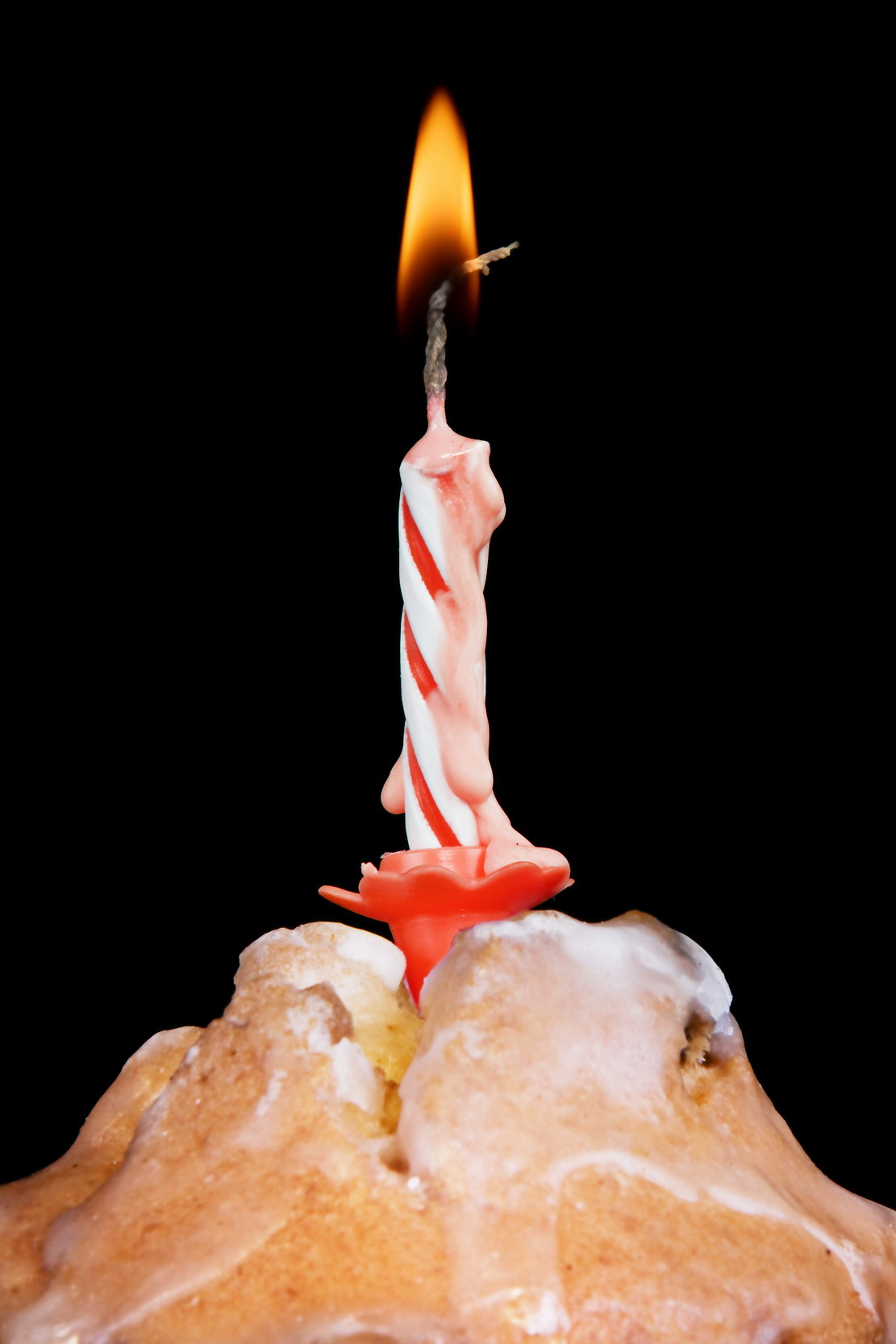 Cupcake with burning candle photo