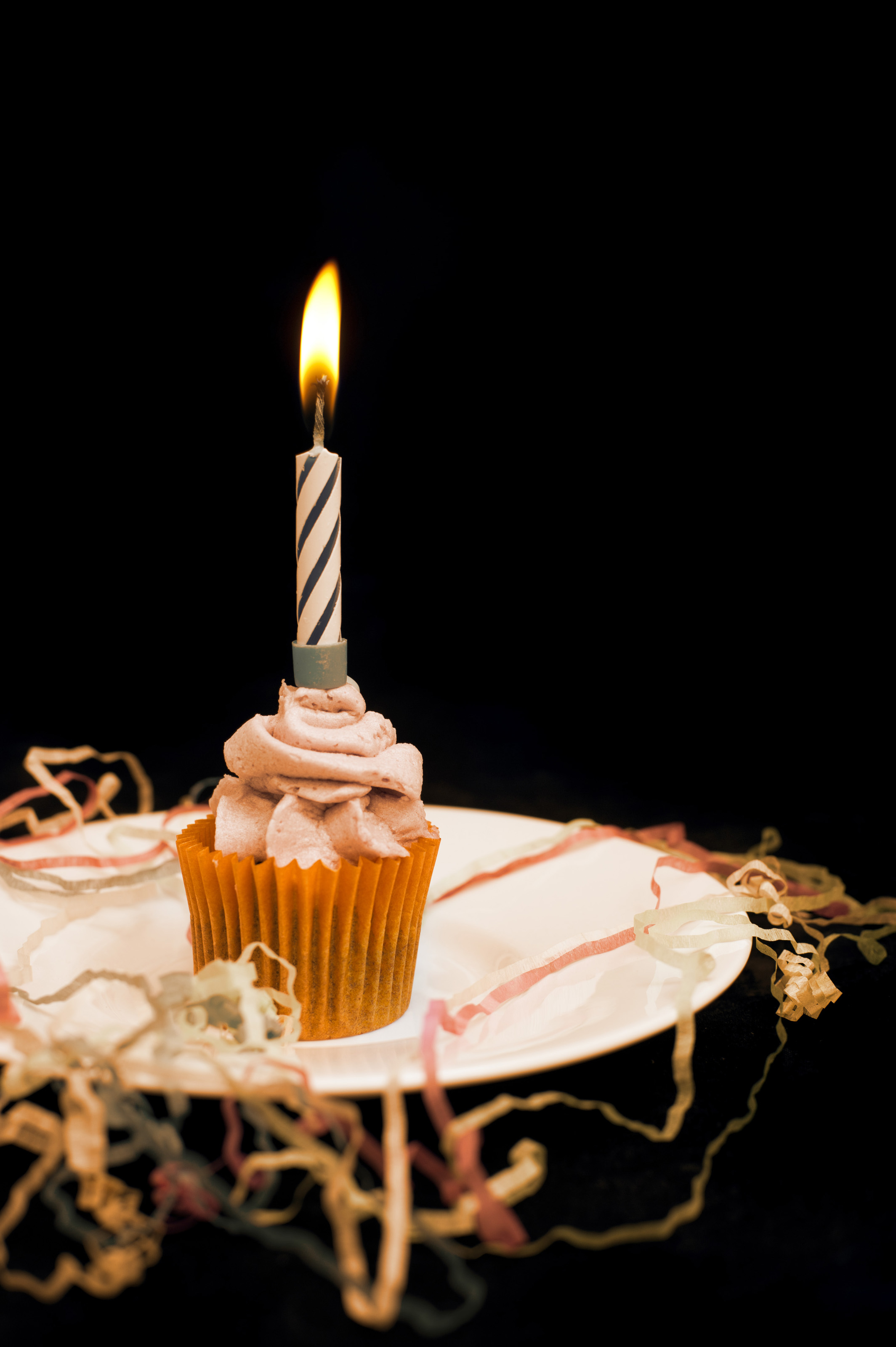 Burning candle on an orange cupcake-6076 | Stockarch Free Stock Photos