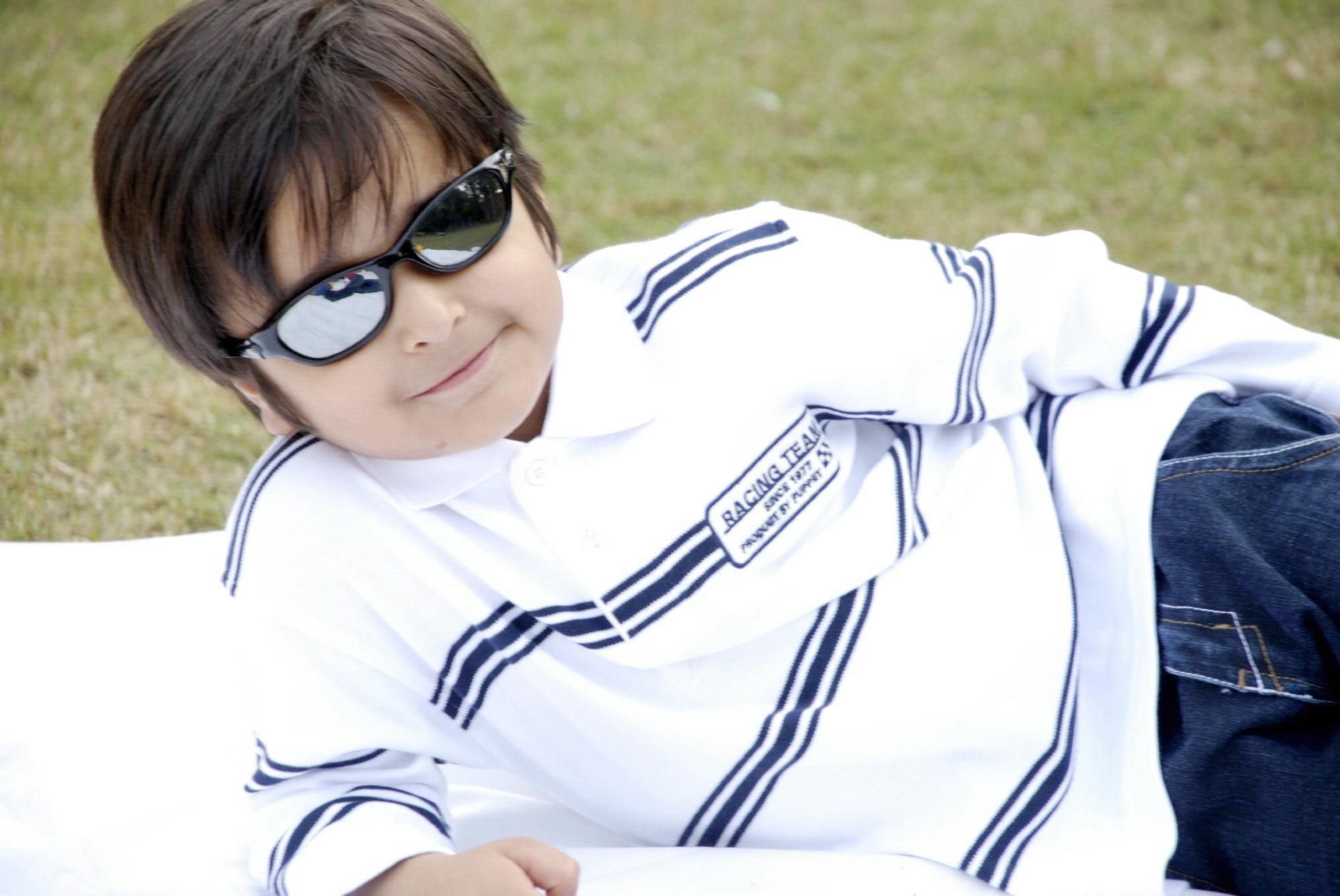Cute boy in glasses photo