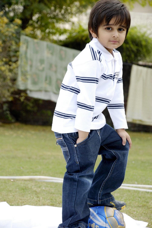 Cute boy with football photo