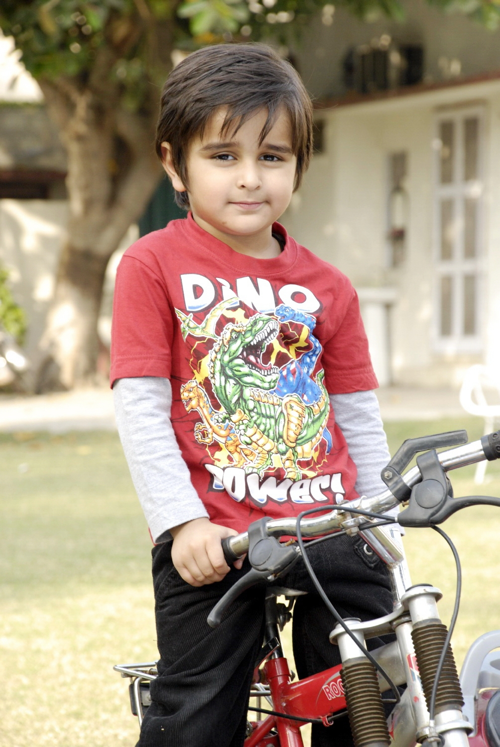 Cute child with bicycle photo