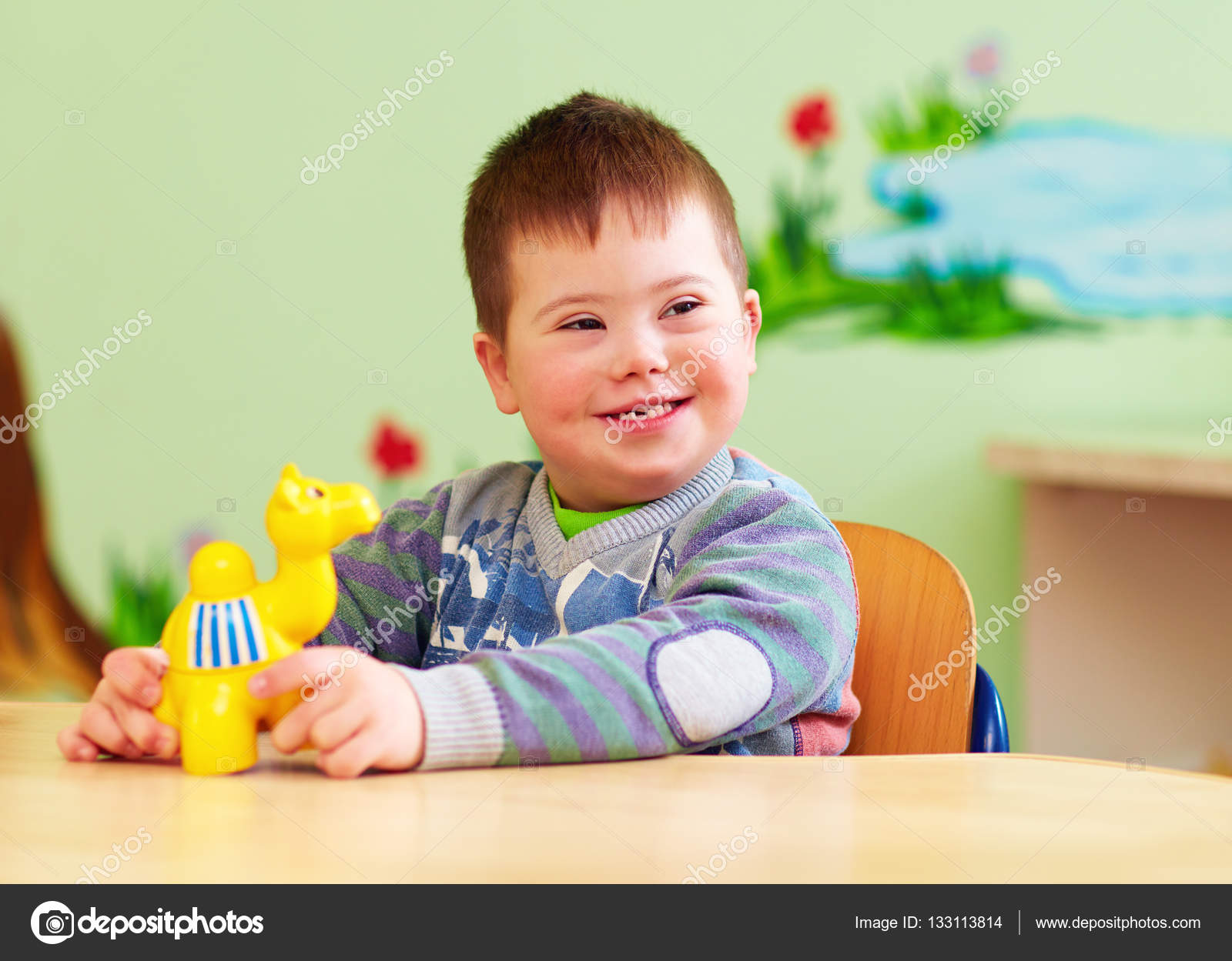 cute kid with down's syndrome playing in kindergarten — Stock Photo ...