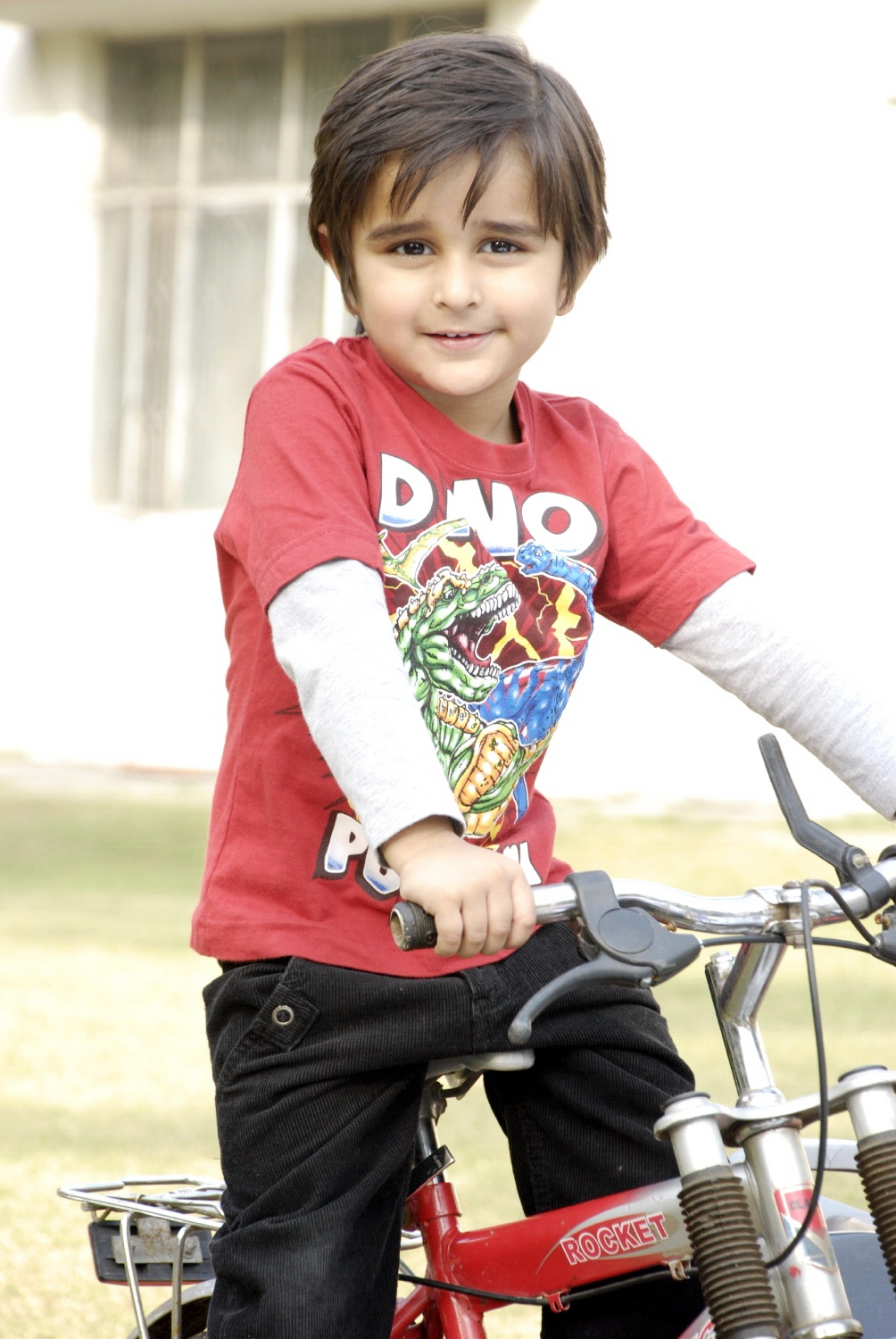 Cute kid with bicycle photo