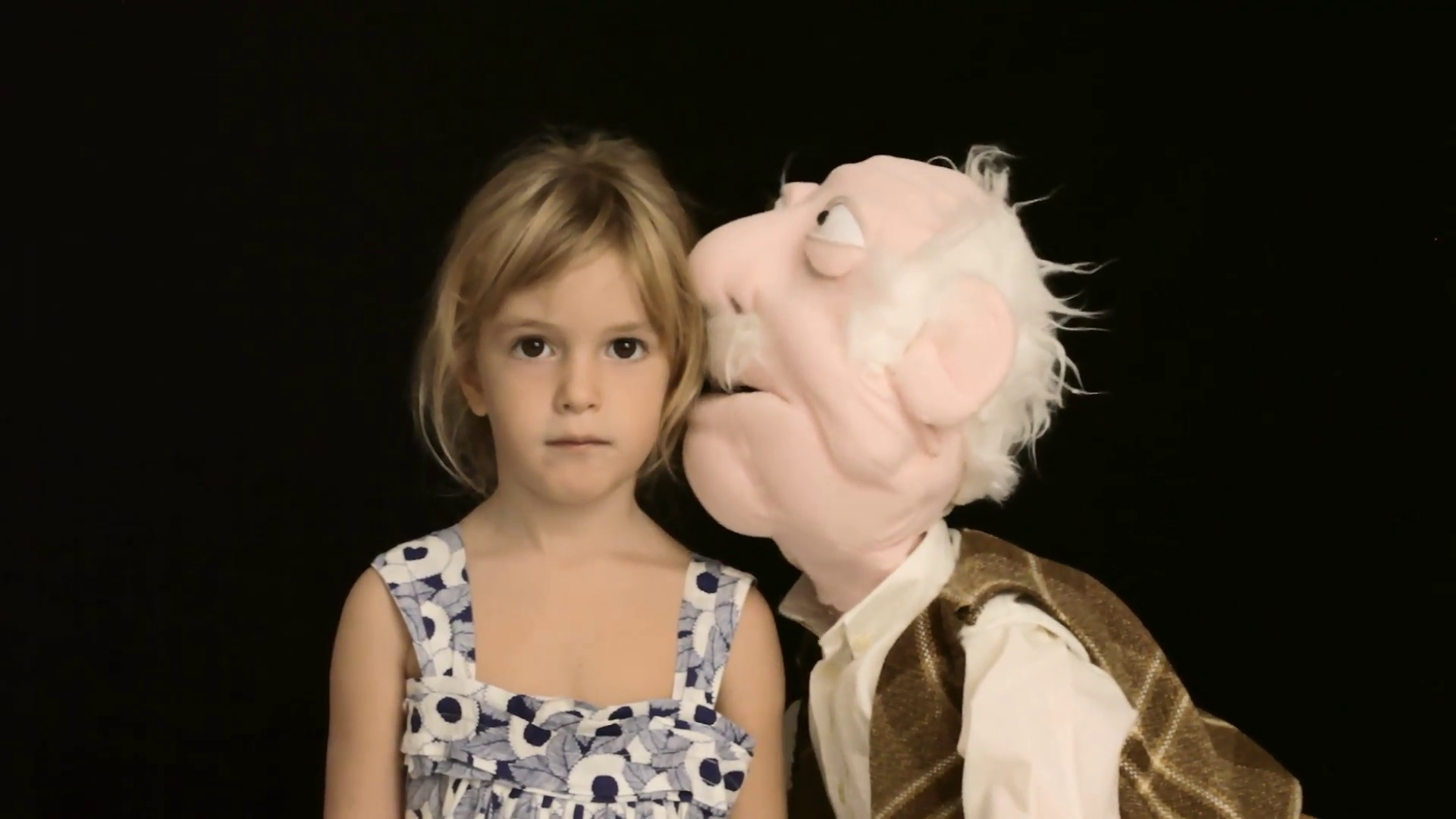 Little girl puppet secret whispering 2. The puppet of an old man ...
