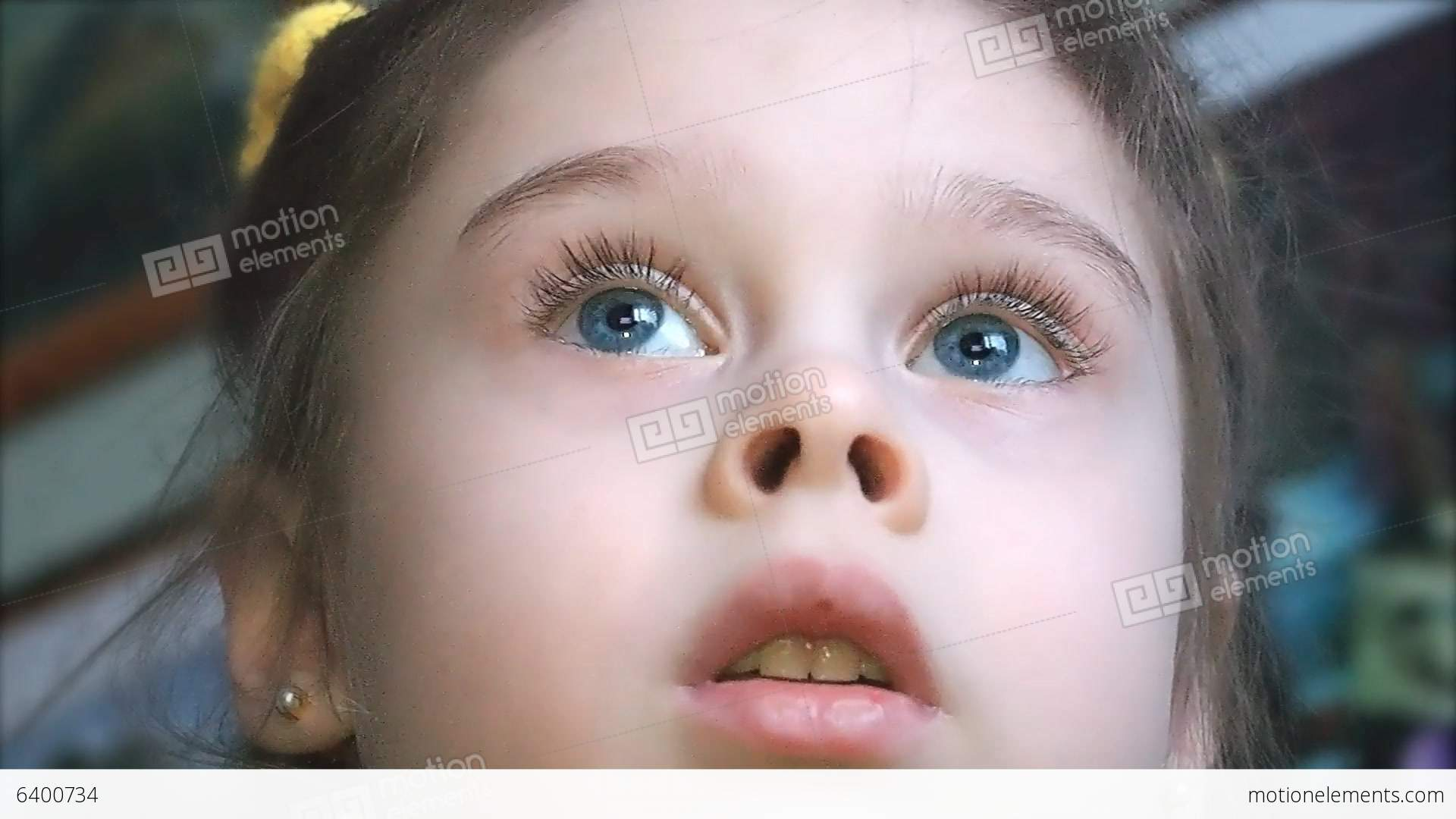 Face Of A Cute Little Girl Watching TV With Intere Stock video ...