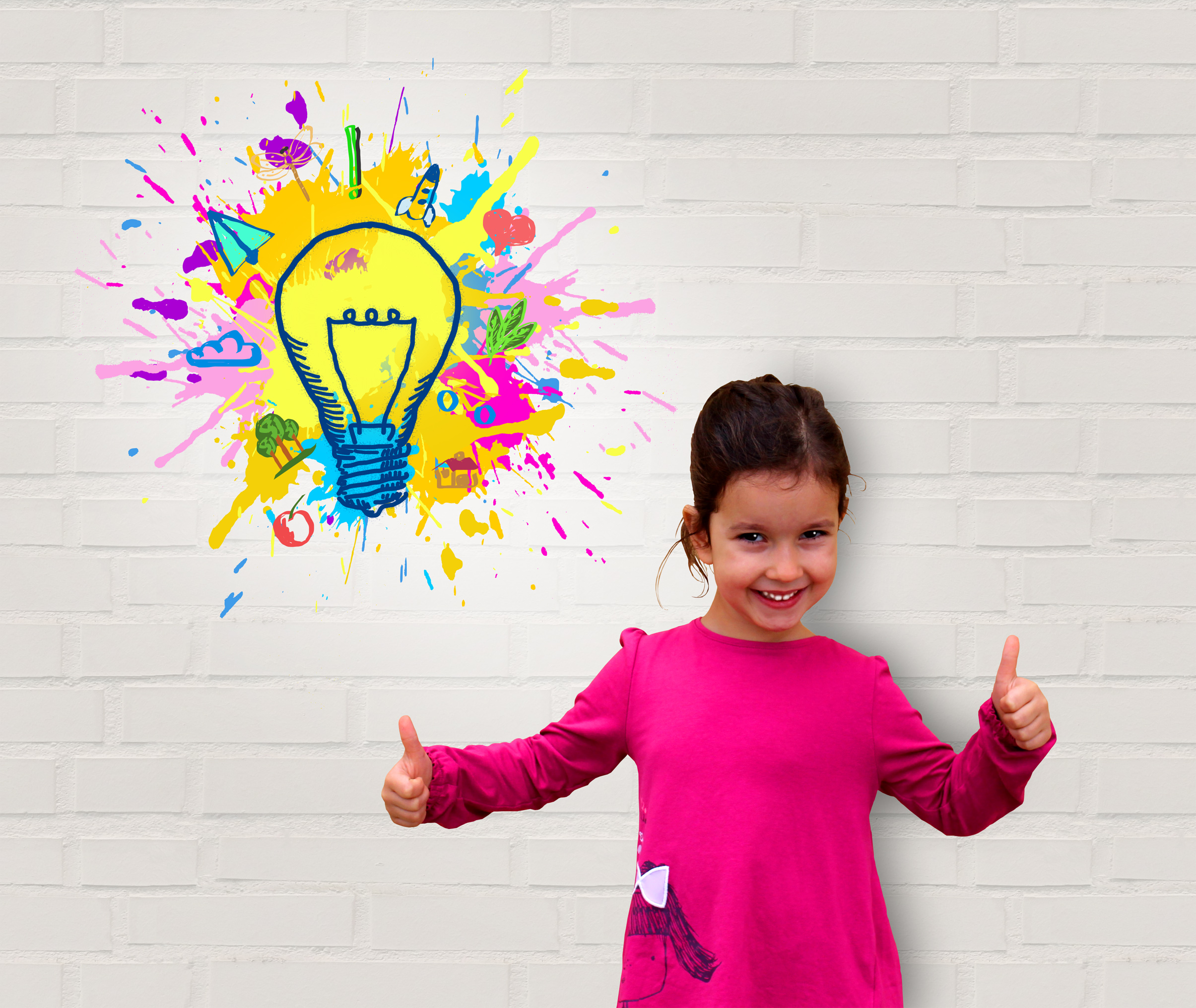 Cute little girl showing thumbs up - creativity and great ideas photo
