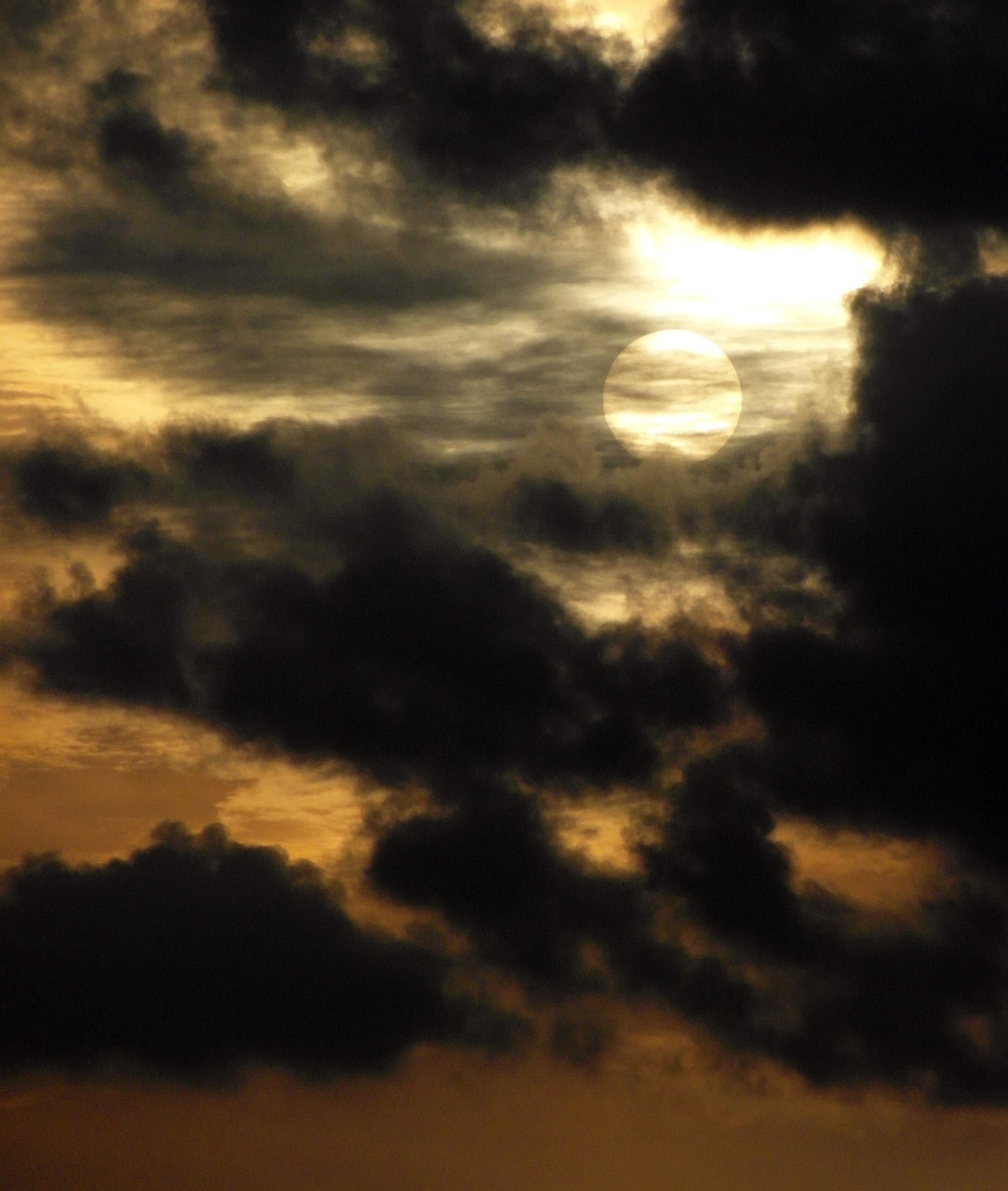 Sun rimmed cloud photo