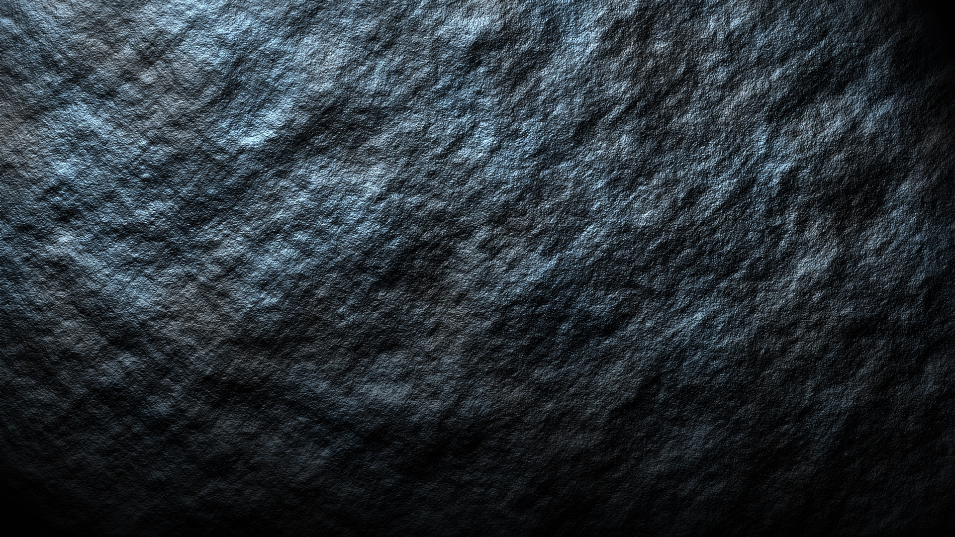 Dark rock surface photo