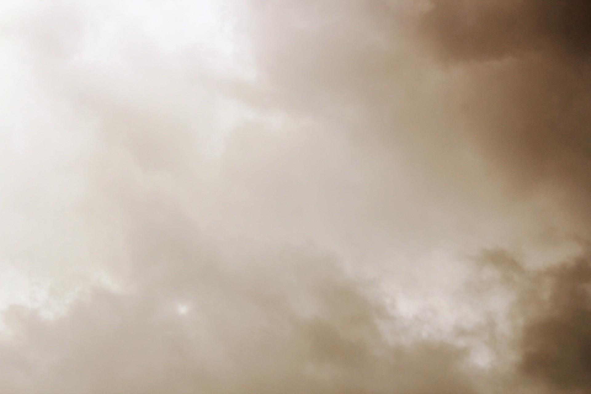 Dark sepia clouds photo
