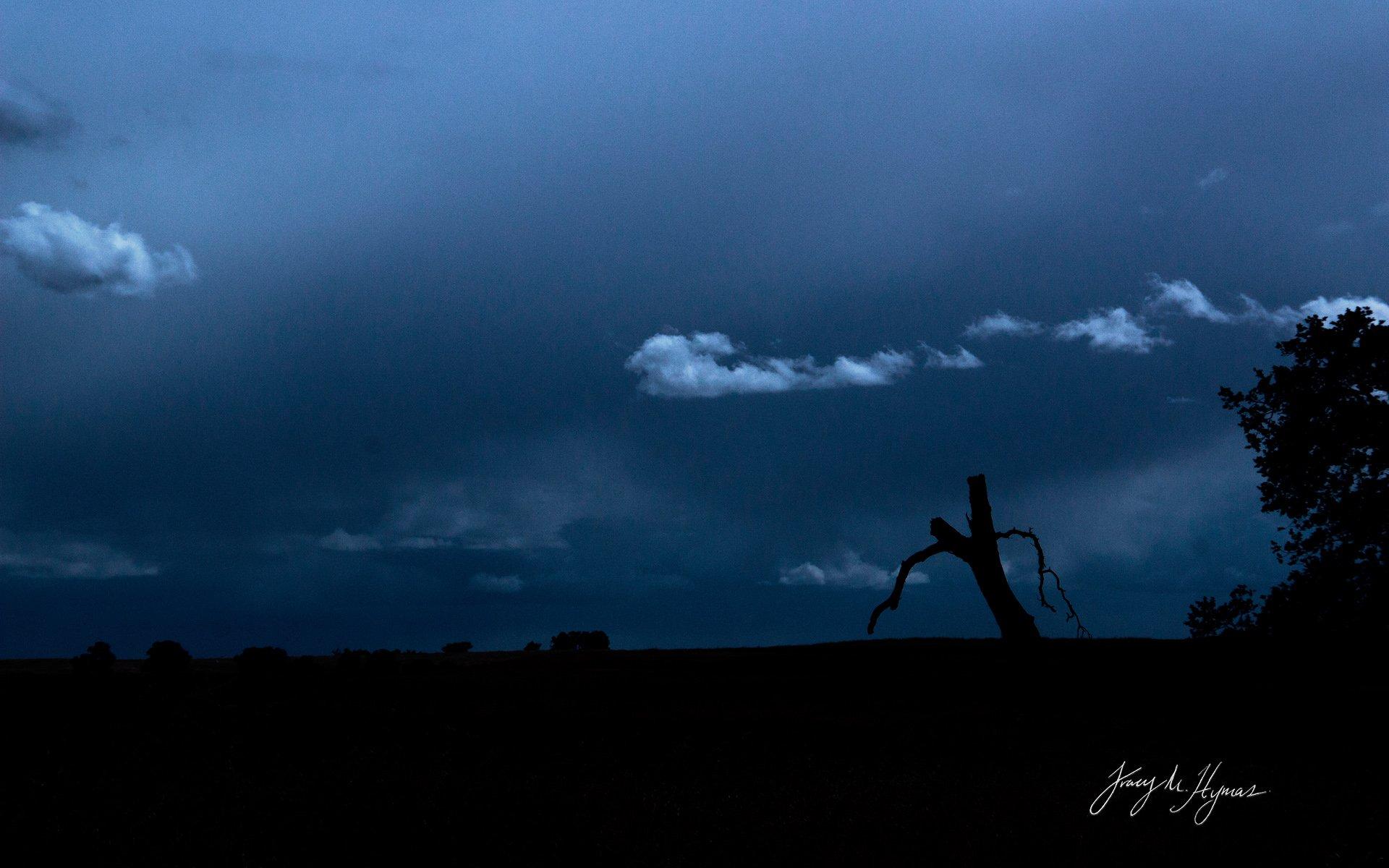 Dark skies silhouette photo