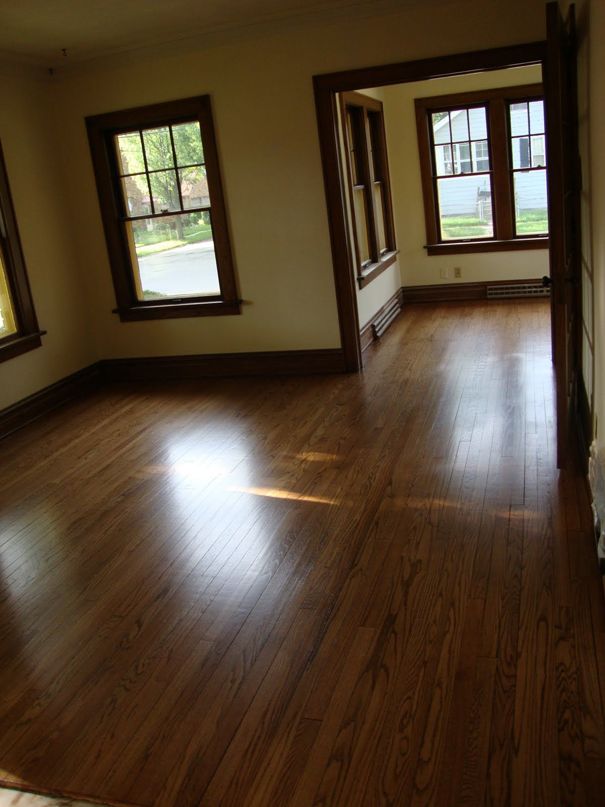 dark wood trim with hardwood floors and lighter, not-sterile white ...
