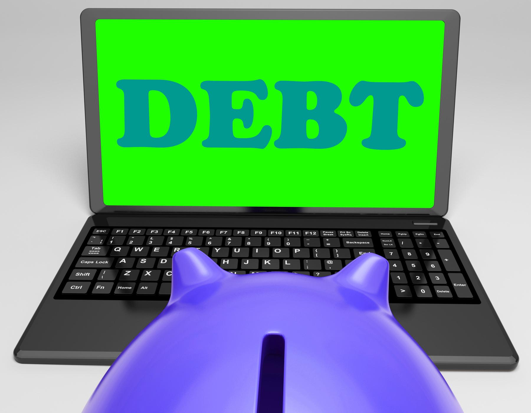 Debt laptop shows money due or owed photo