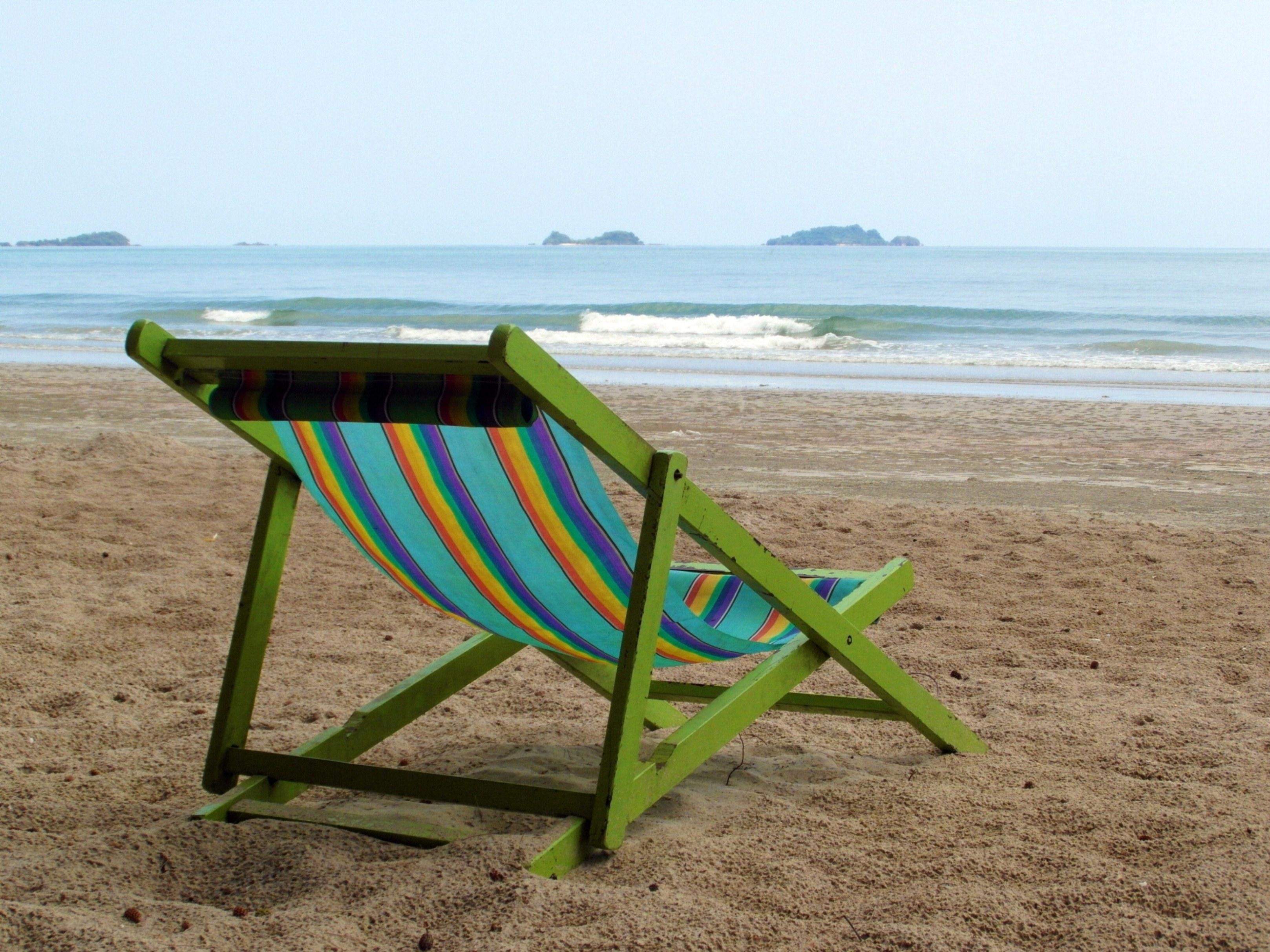 Deckchair on an empty beach photo