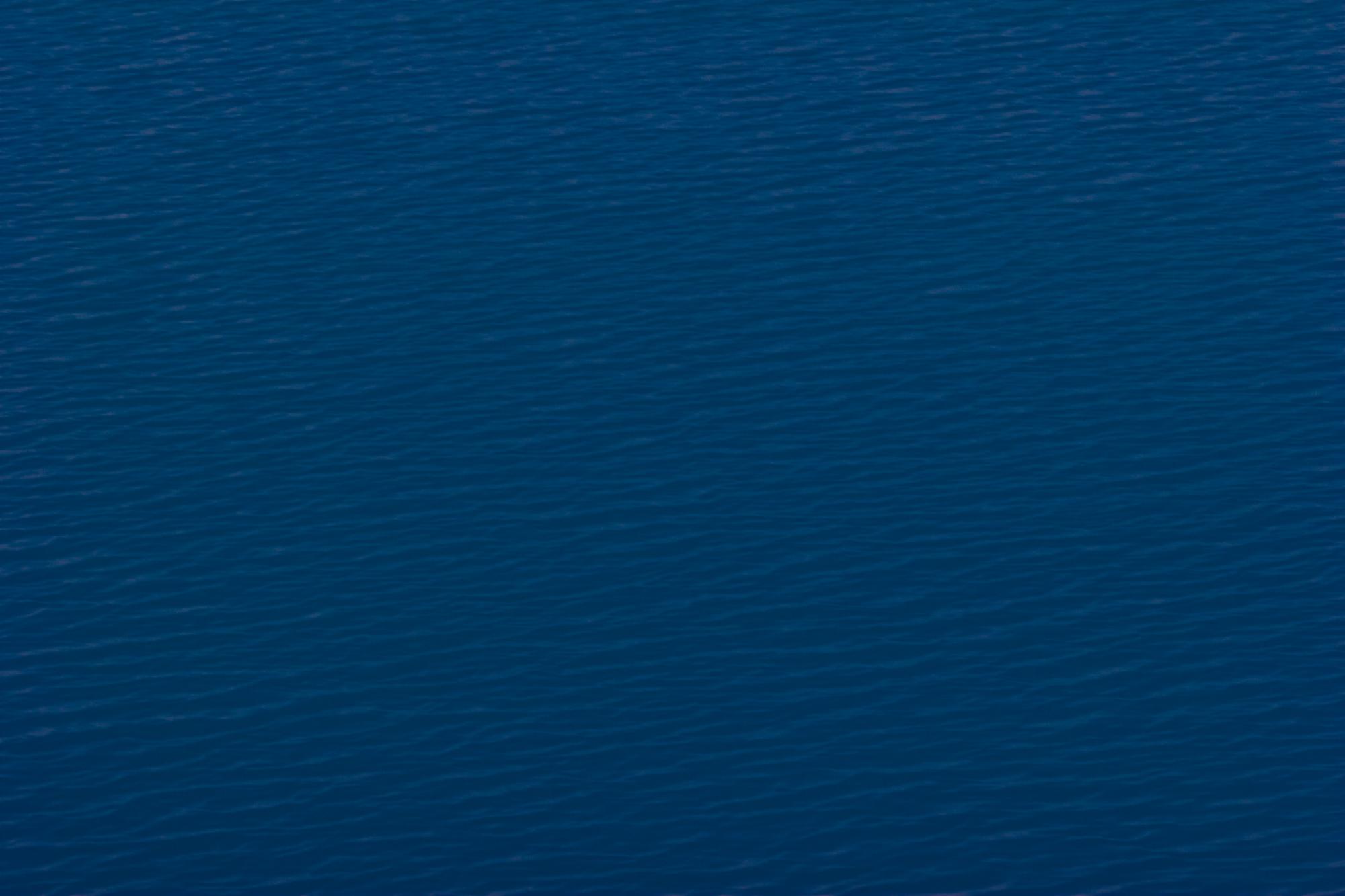 Deep blue water texture photo