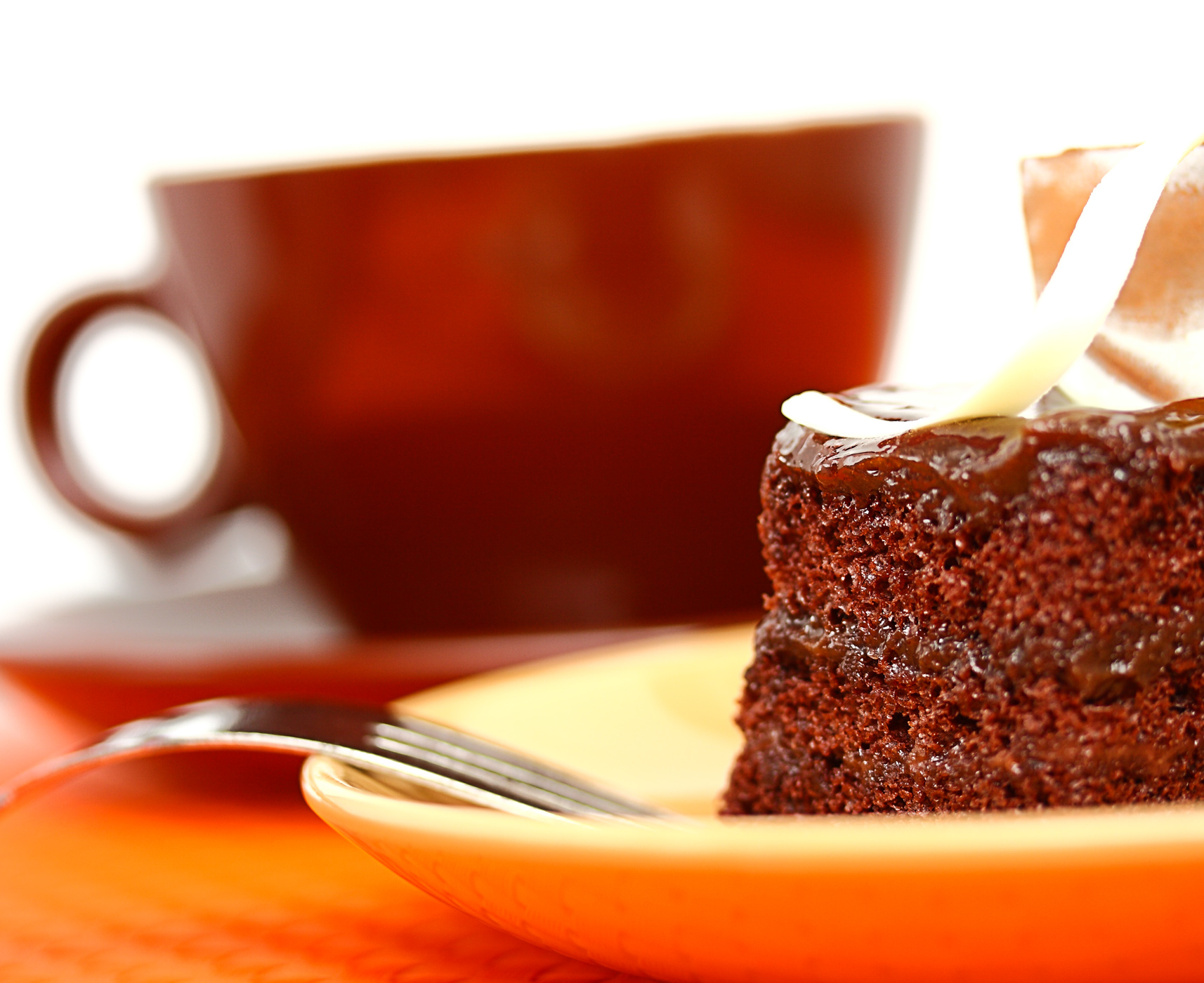 Delicious piece of moist chocolate cake with coffee photo