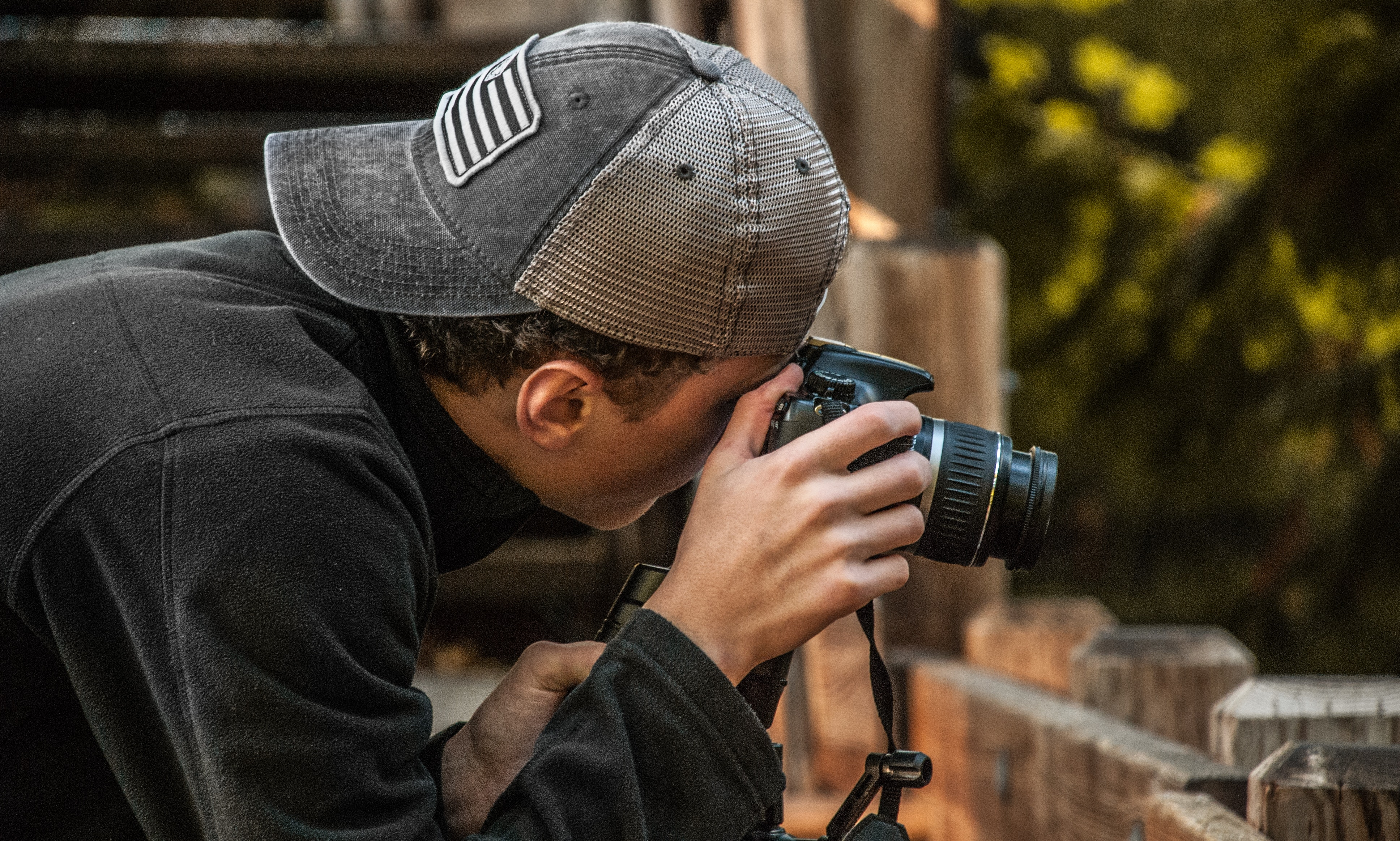 Depth of Field Photography of Man Holding Dslr Camera, Person, Work, Wear, Trees, HQ Photo