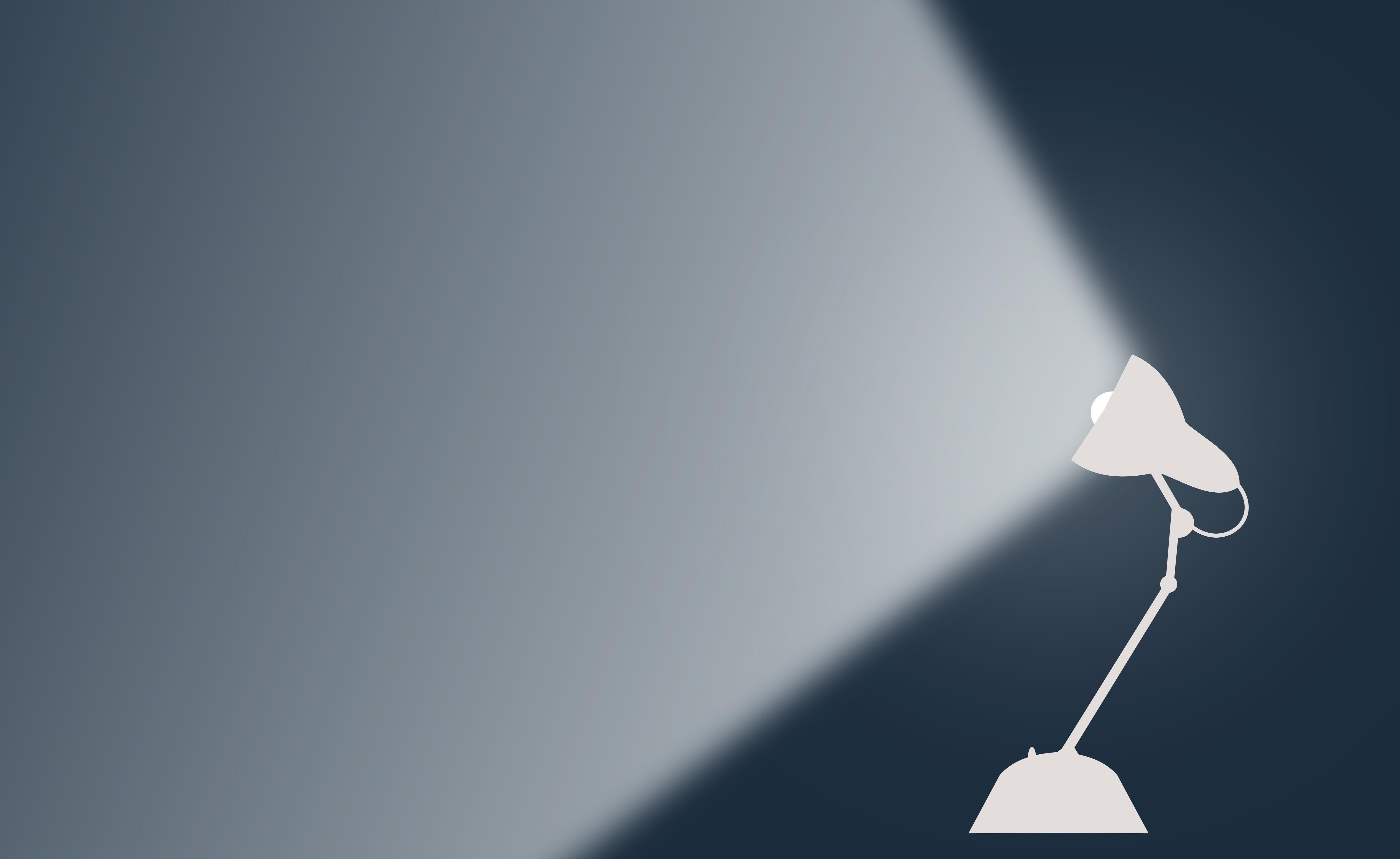 Desk lamp casting light - with copyspace photo