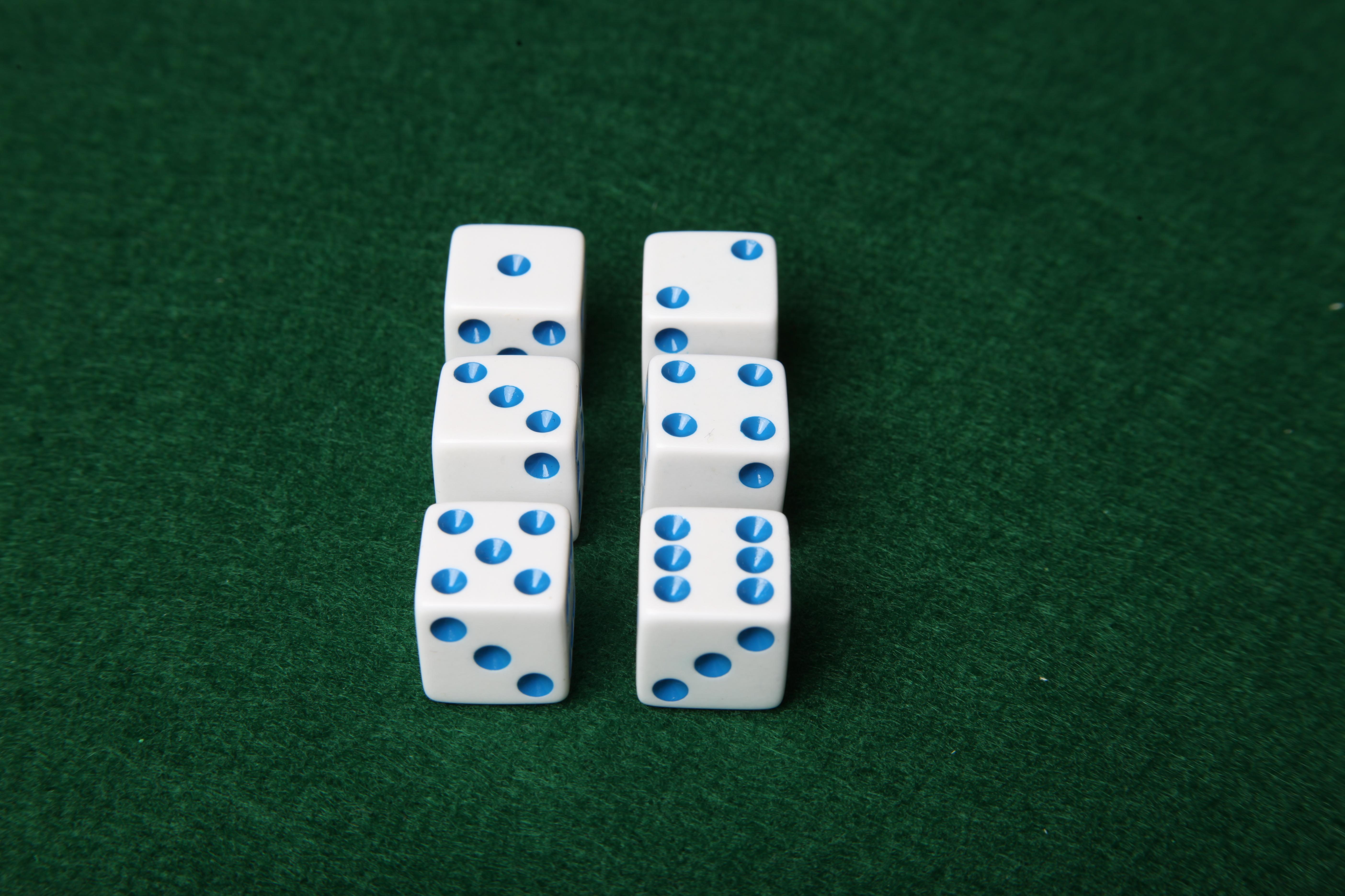 Dice on green felt table photo