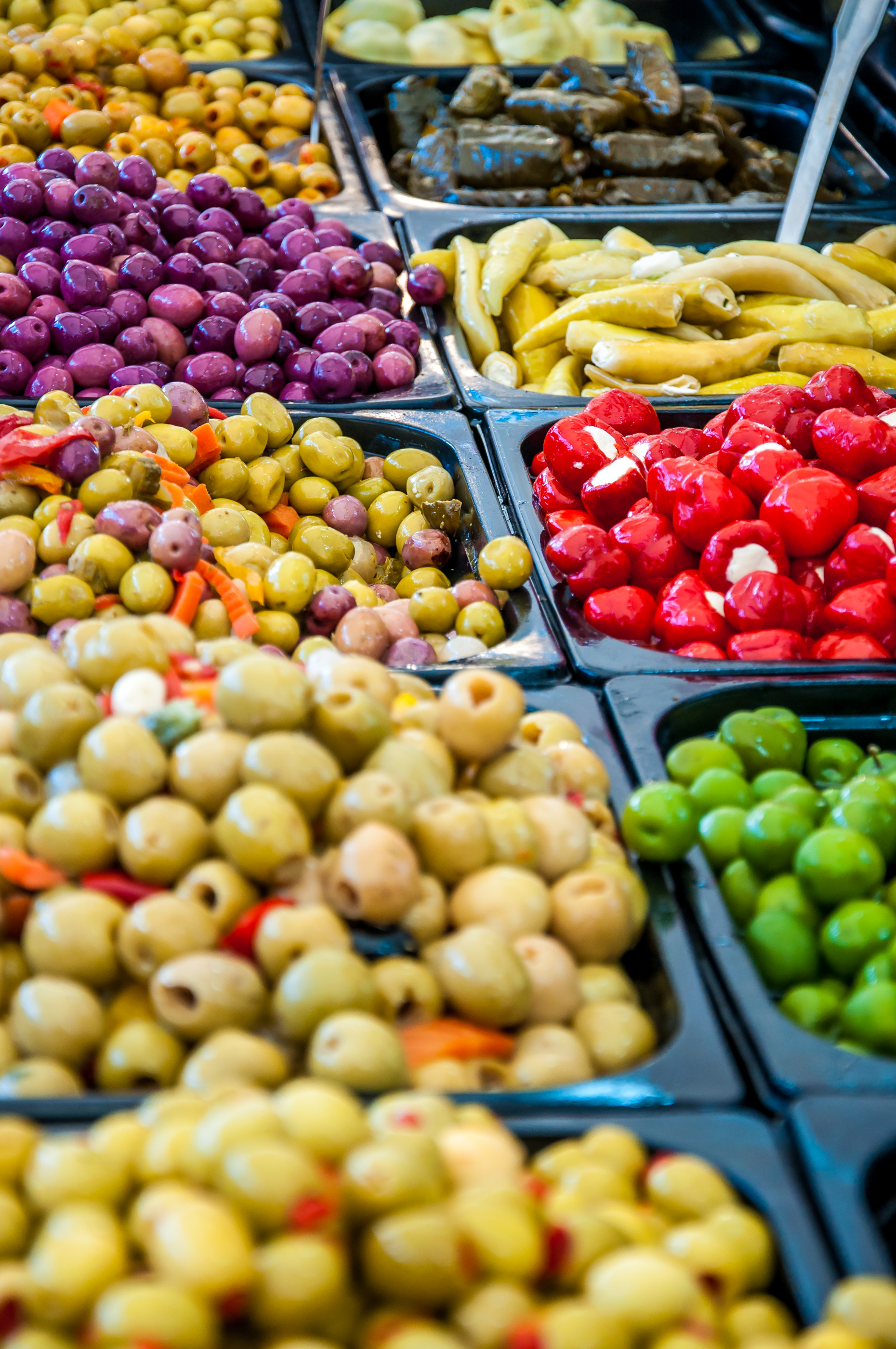 Different marinated olives in market photo