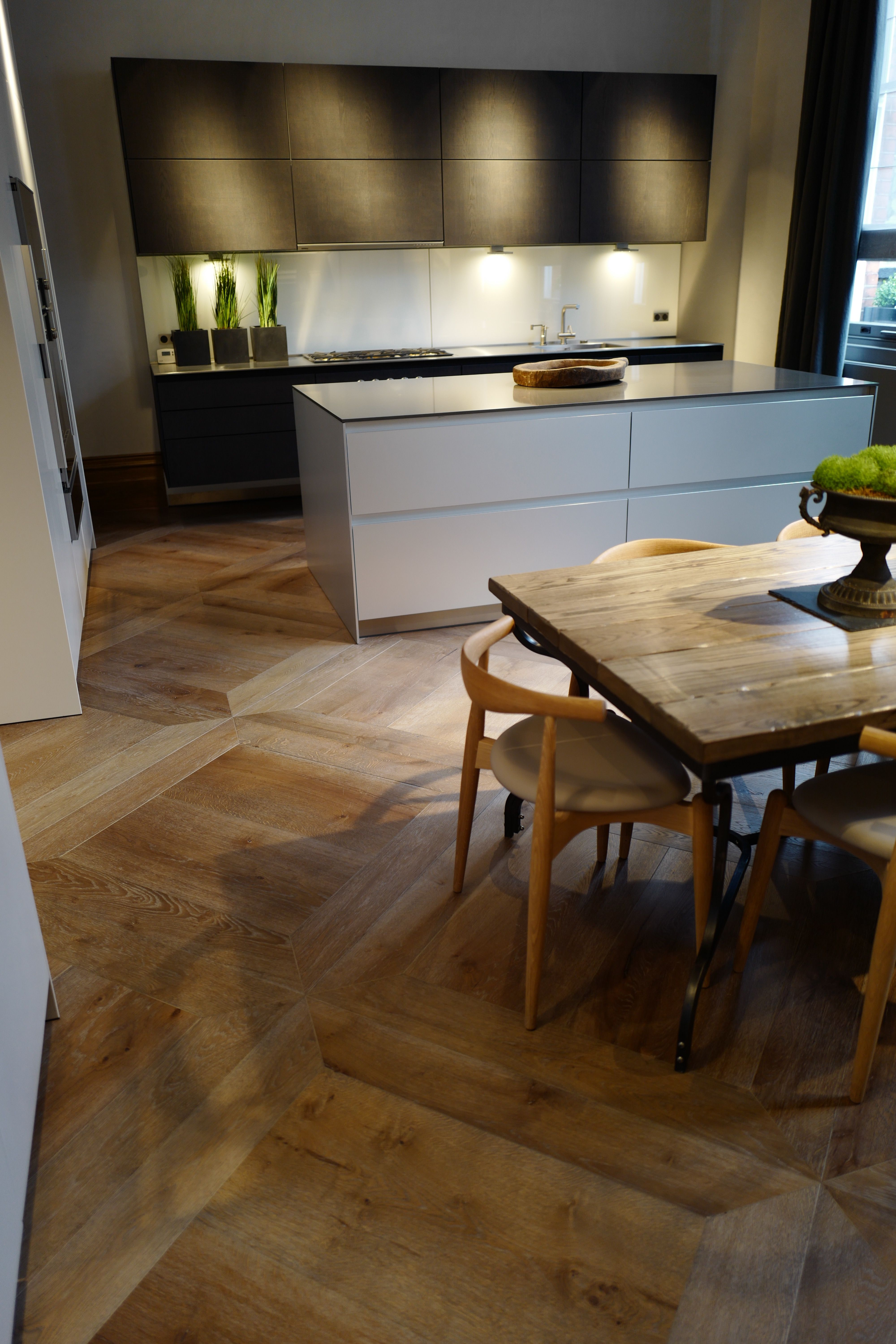 Antique grey distressed engineered flooring enhances this kitchen ...