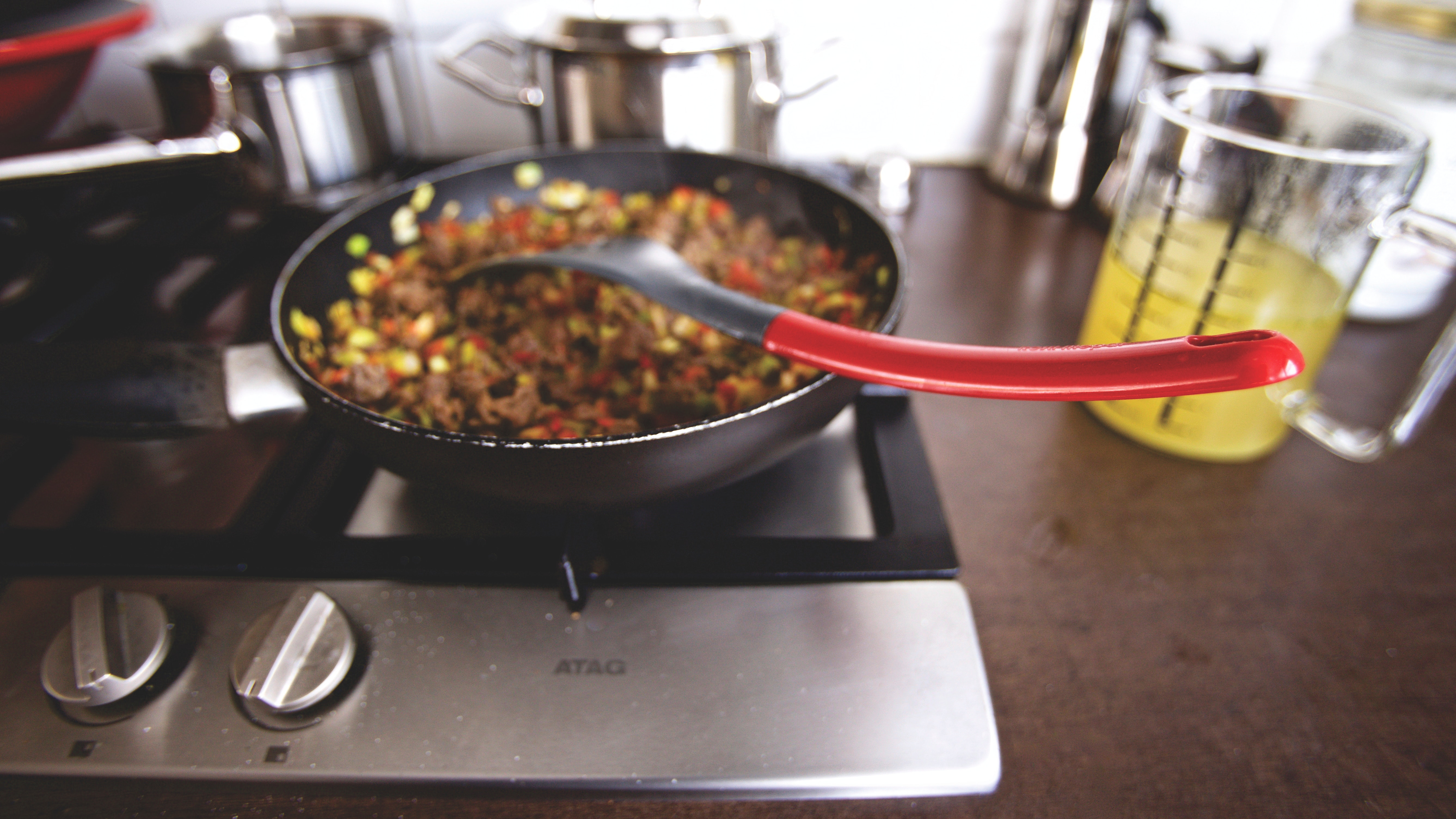 Dish cooking on black non stick pan on a burner photo