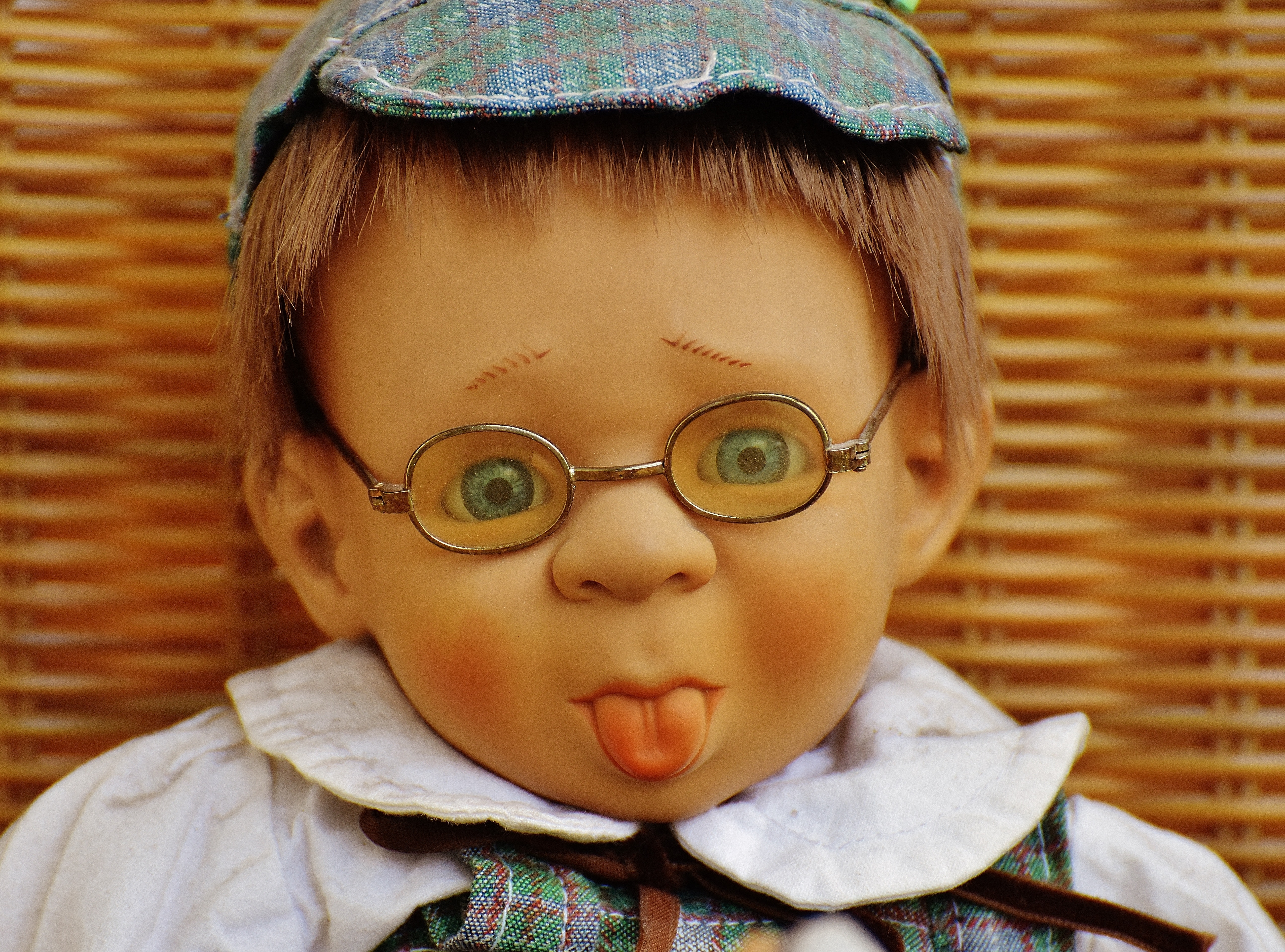 Doll Wearing Eyeglasses, Indoors, Young, Toys, Tongue, HQ Photo