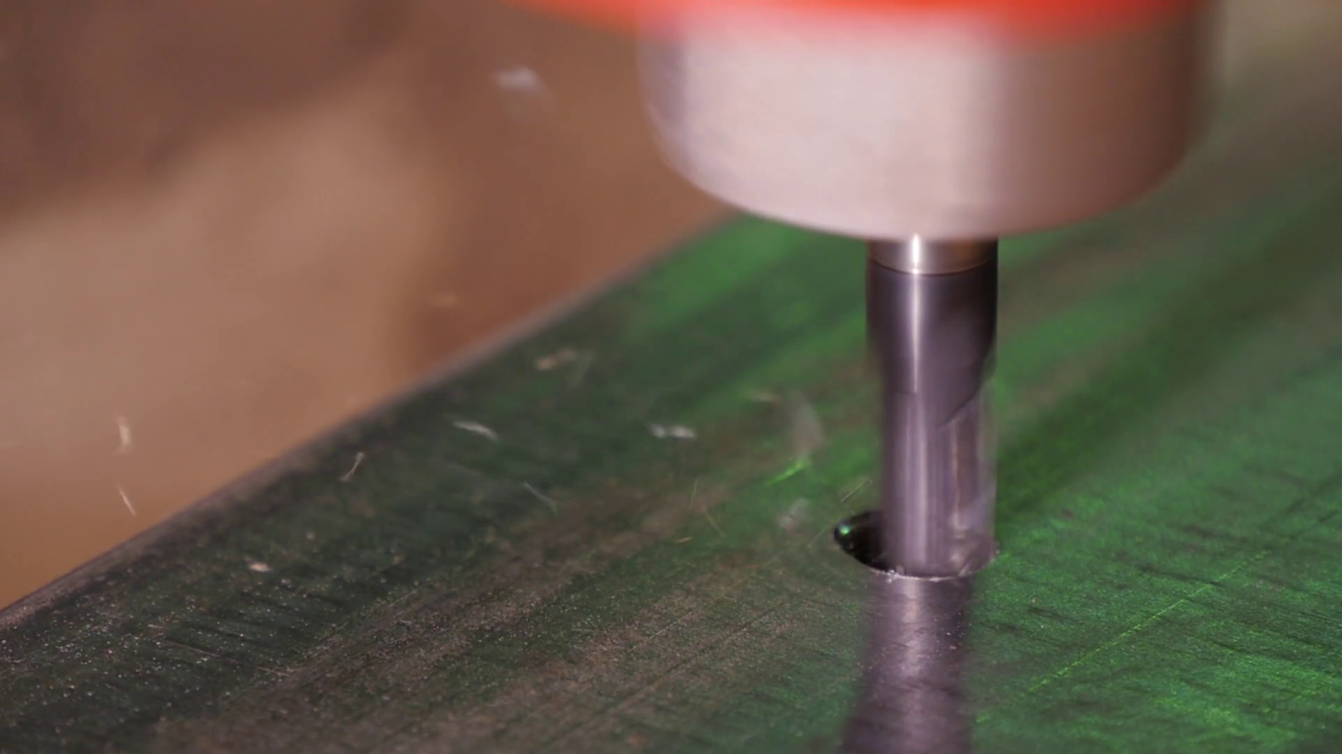 Hole being drilled into metal. Metal drilling closeup in metal ...