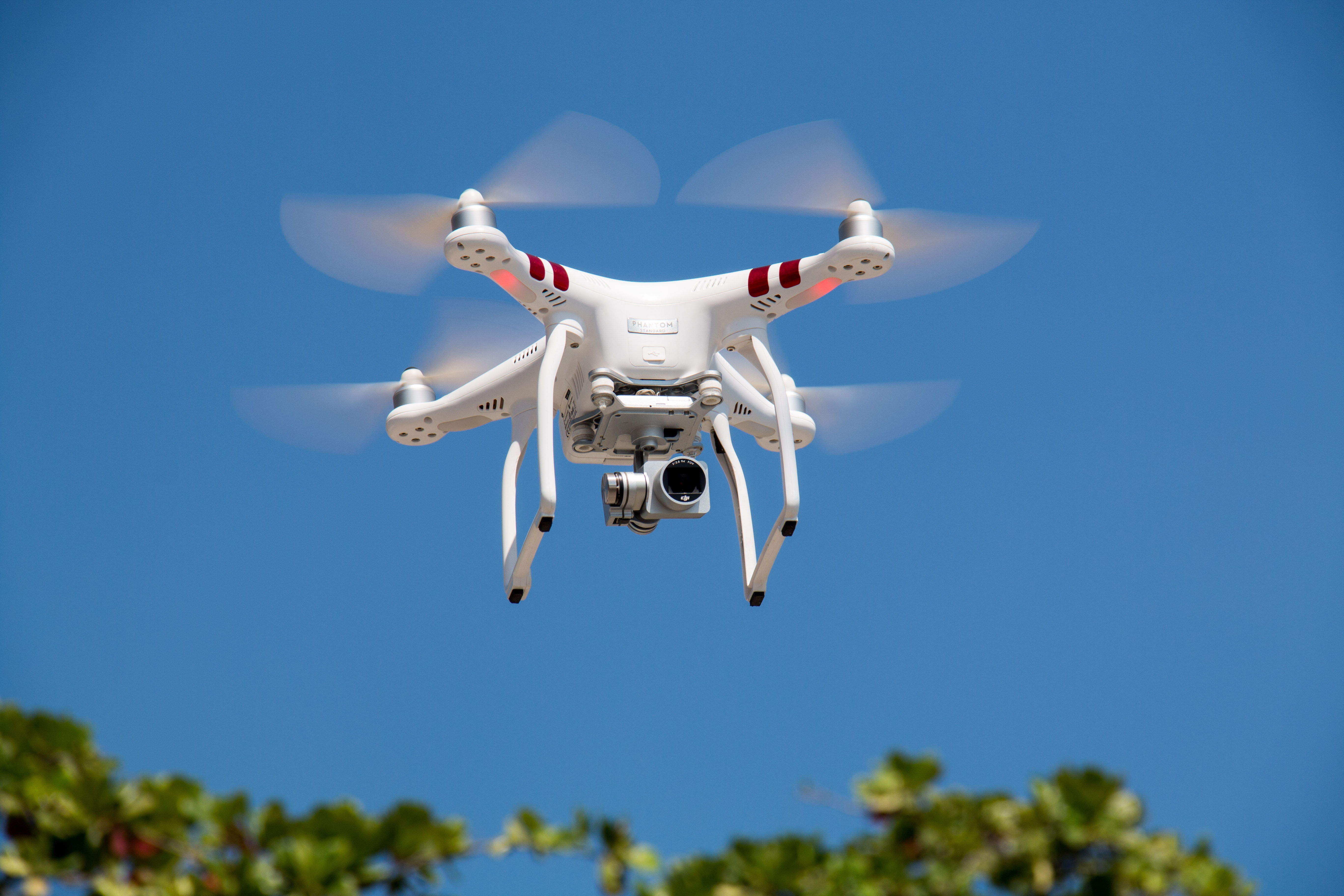 Drone flying against blue sky photo