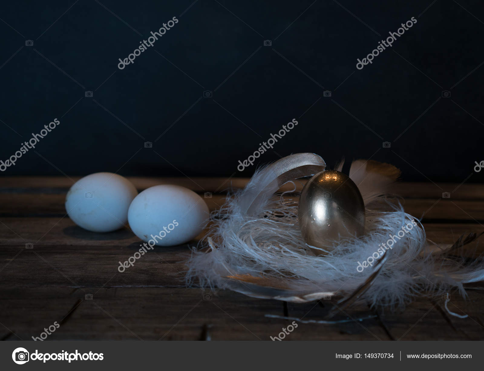 Easter. Easter night. Golden and White eggs, feathers on a wooden ...