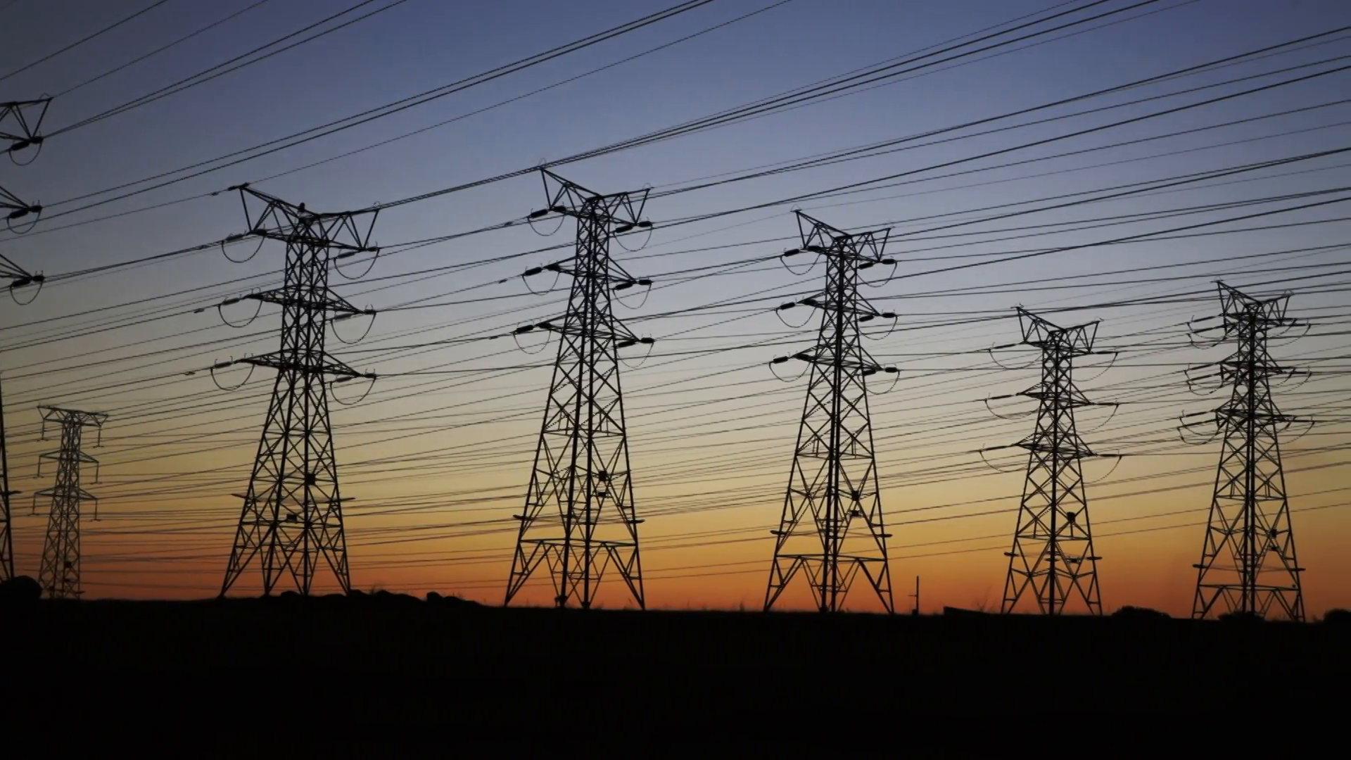 Pan of electrical power lines and pylons at dusk Stock Video Footage ...