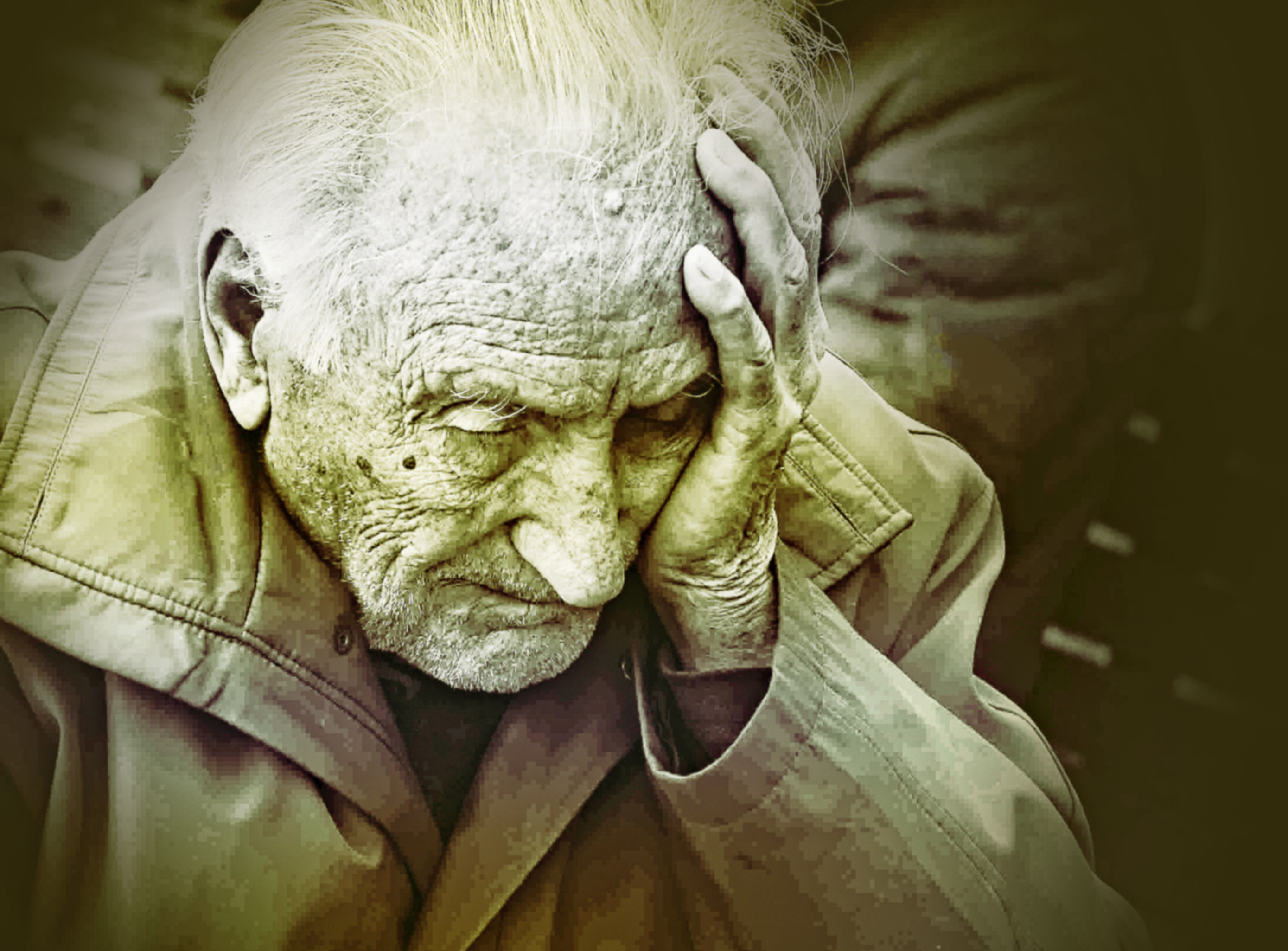 Emotional colorized portrait of elderly man worrying photo