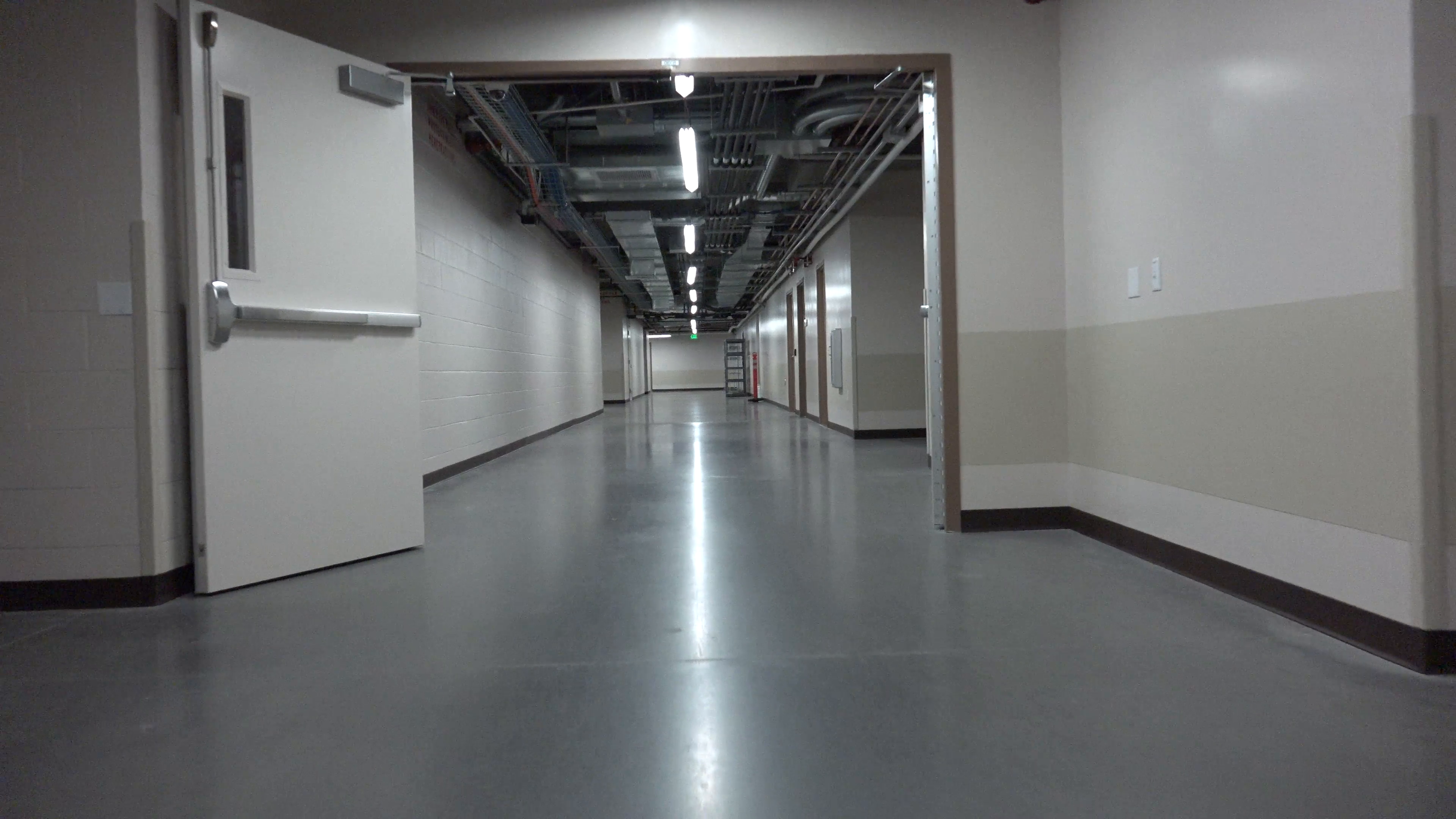 Walk POV Through Empty Shiny Hospital Basement Hallway Stock Video ...