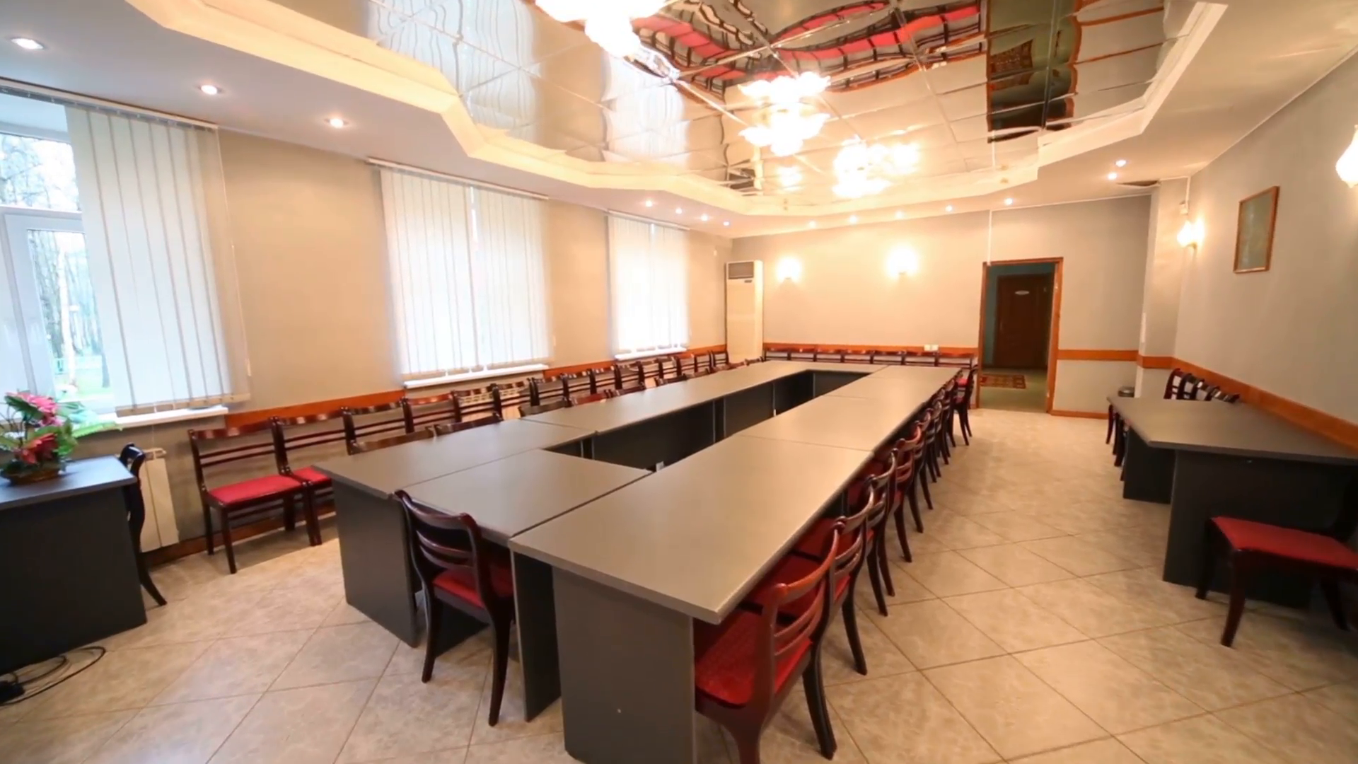 Modern interior of empty meeting room with long conference table and ...