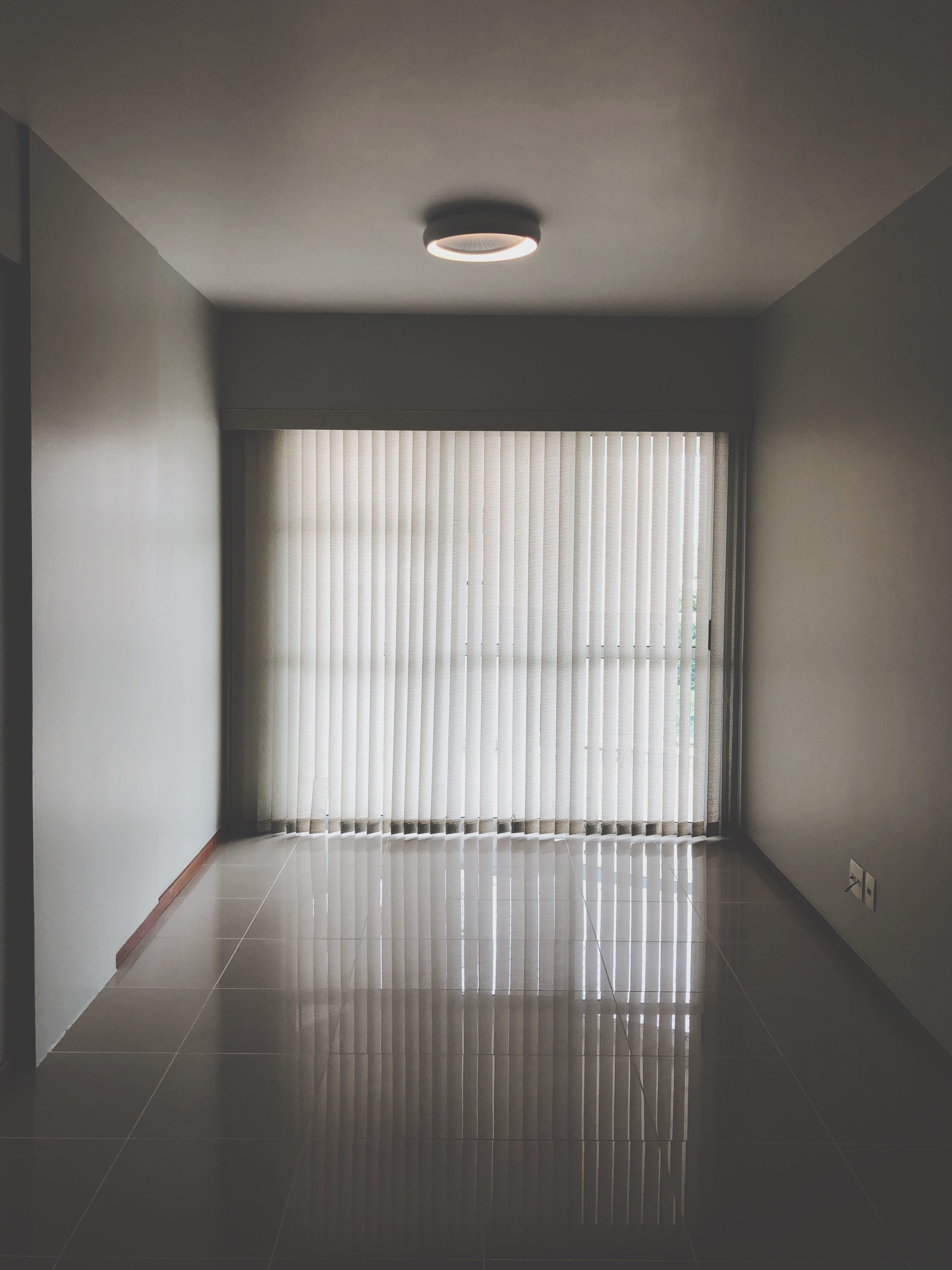 Empty room with closed window curtains photo