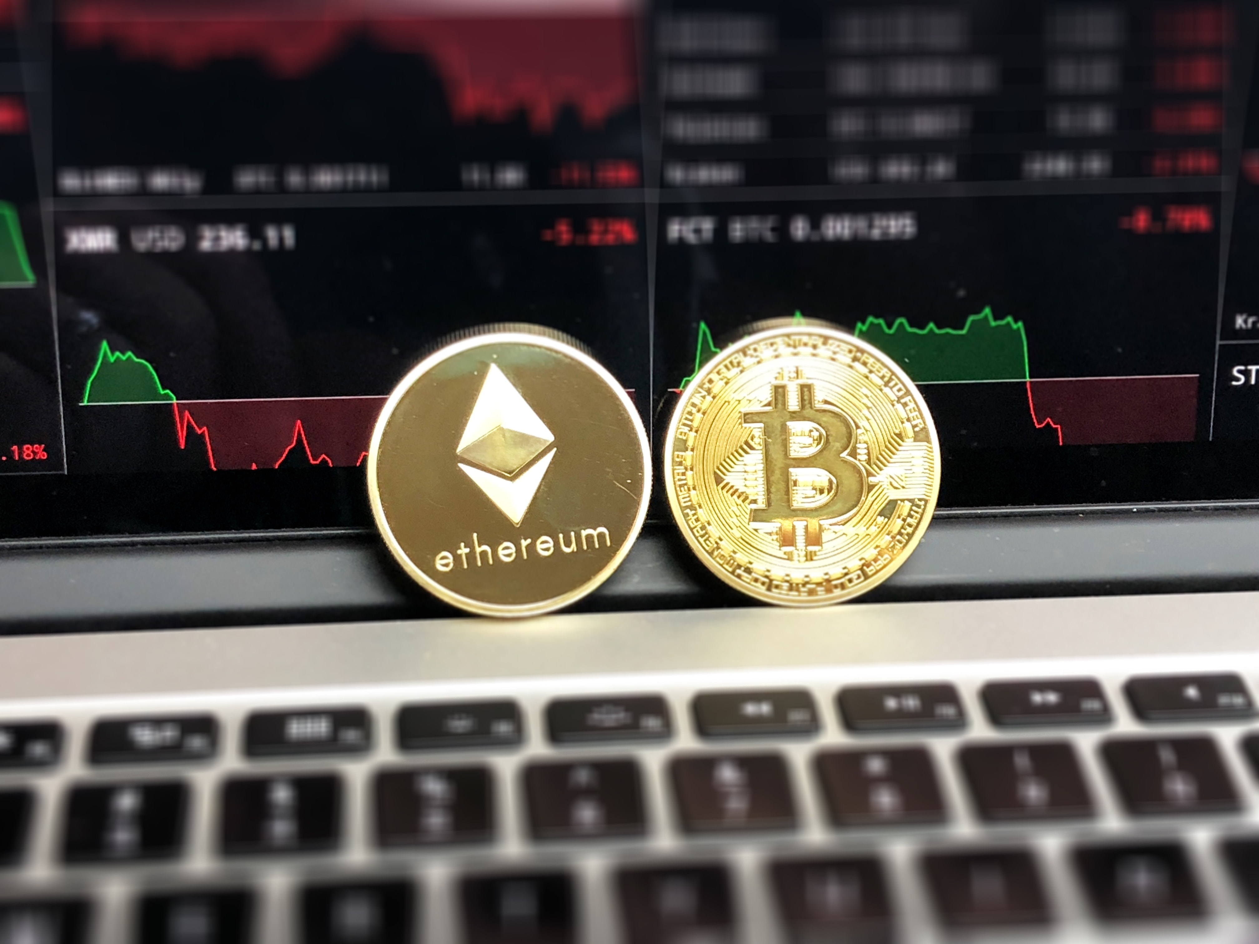 Ethereum and bitcoin emblems photo