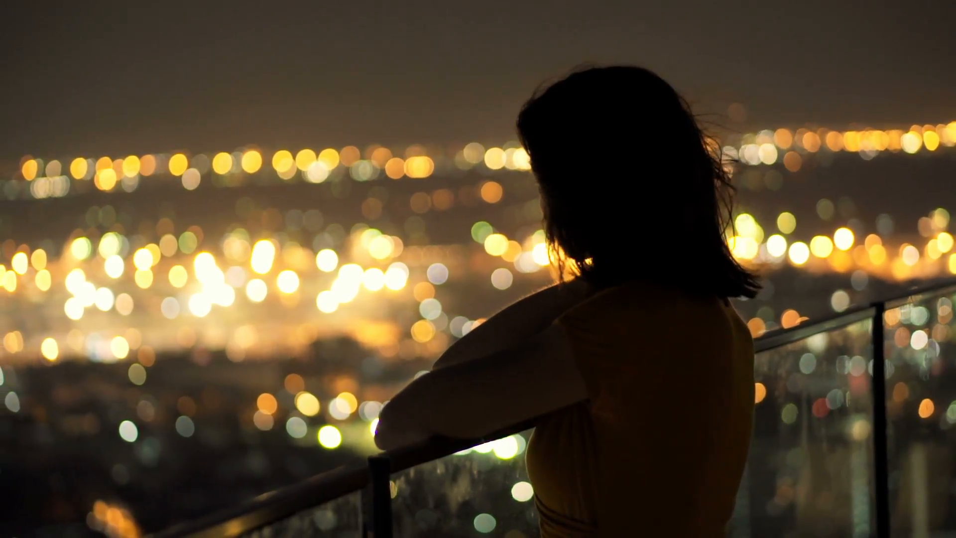 Young pensive woman looking at cityscape in the evening lights HD ...