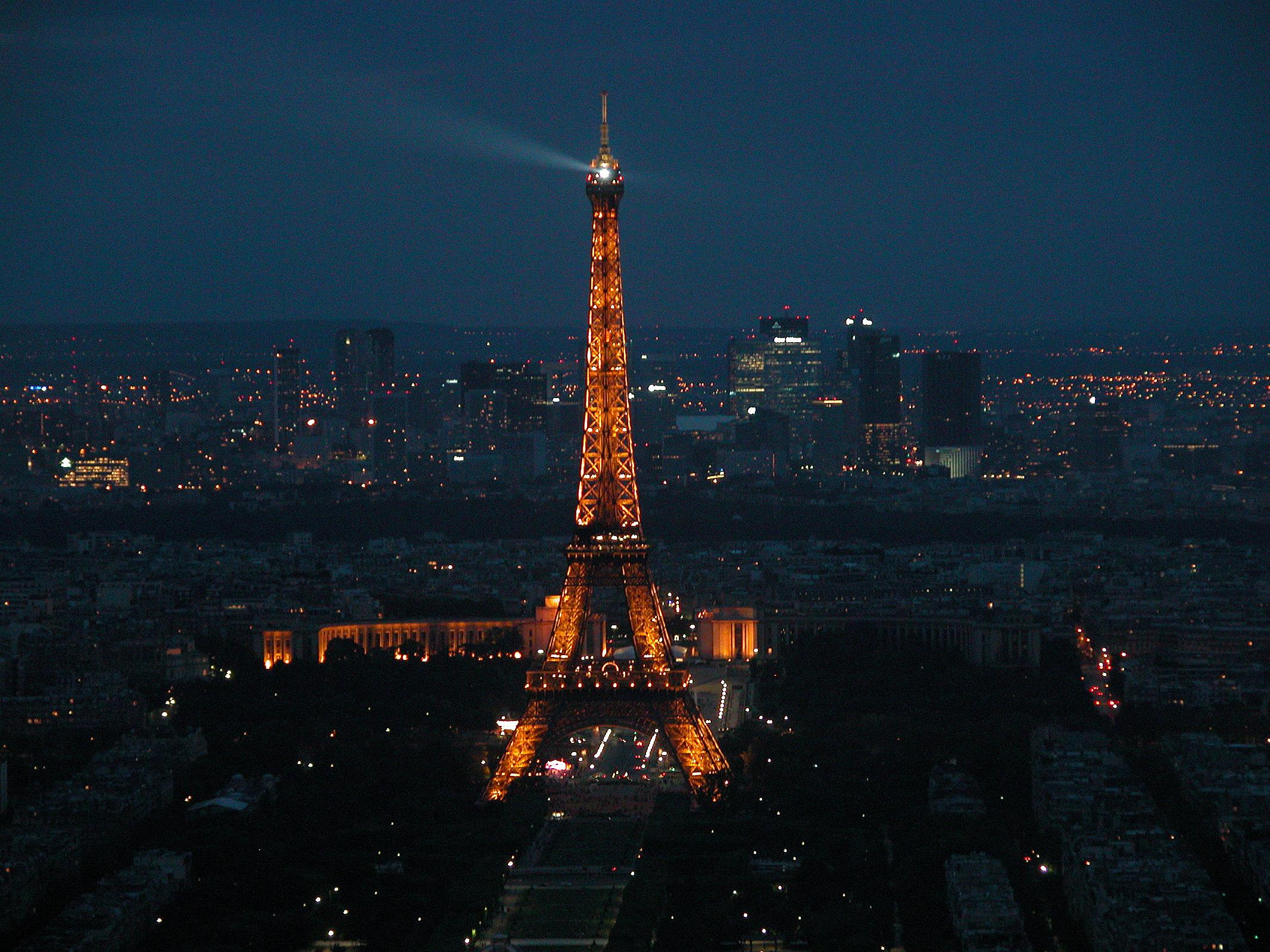 Paris 09 Evening Lights On Eiffel Tower With La Defense Behind From ...