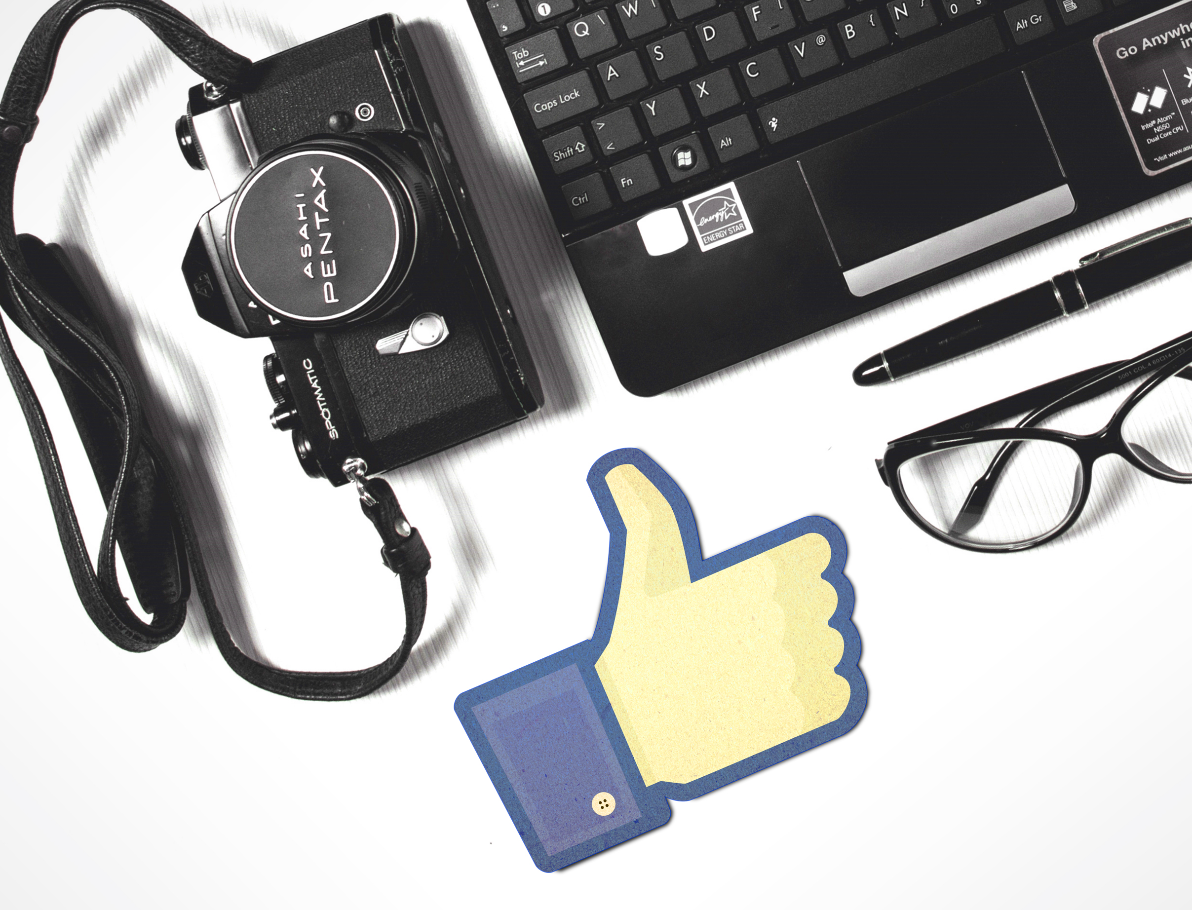 Facebook thumbs-up with laptop and camera photo
