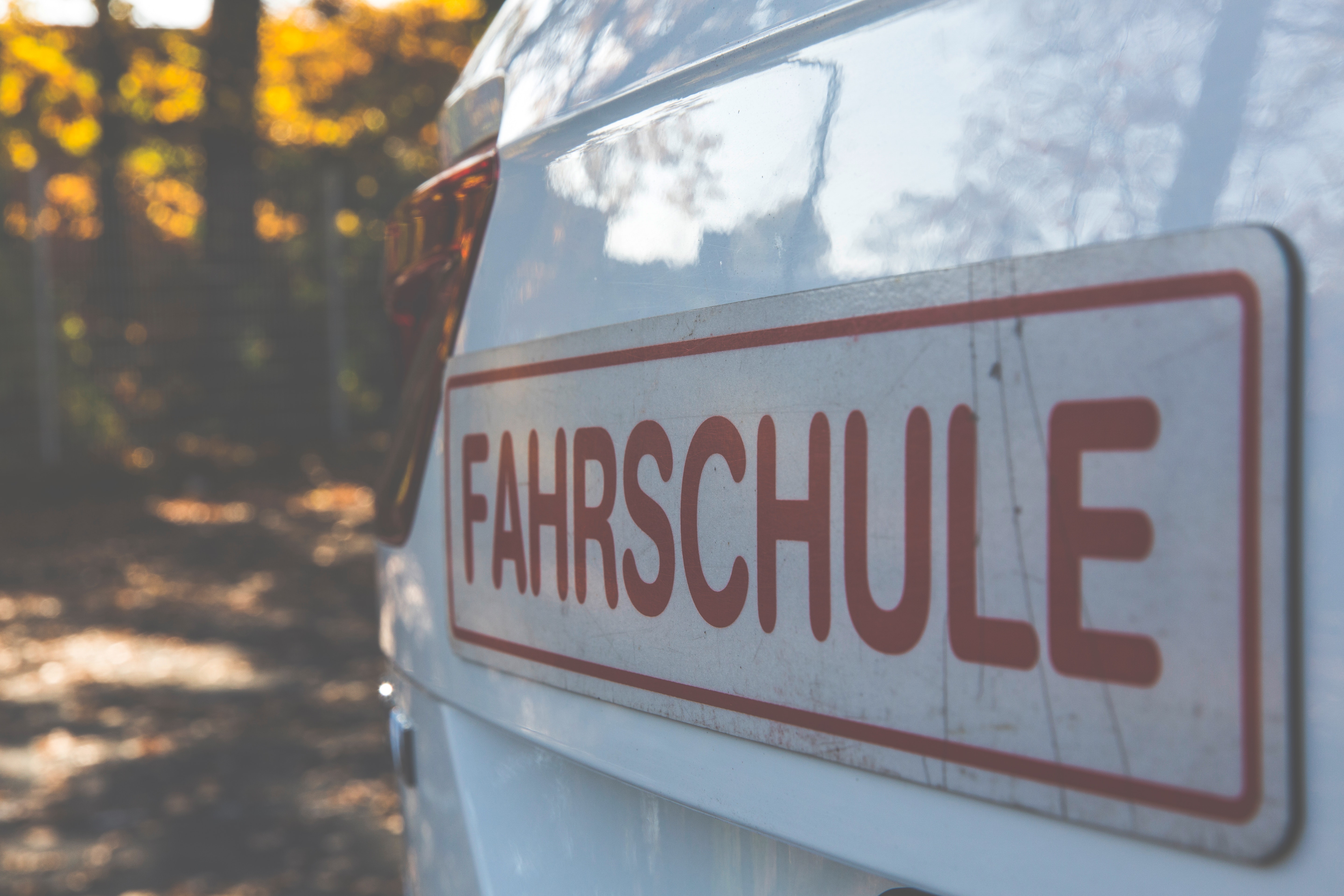 Fahrschule Signboard, Automobile, Rear, Turn signal, Trees, HQ Photo