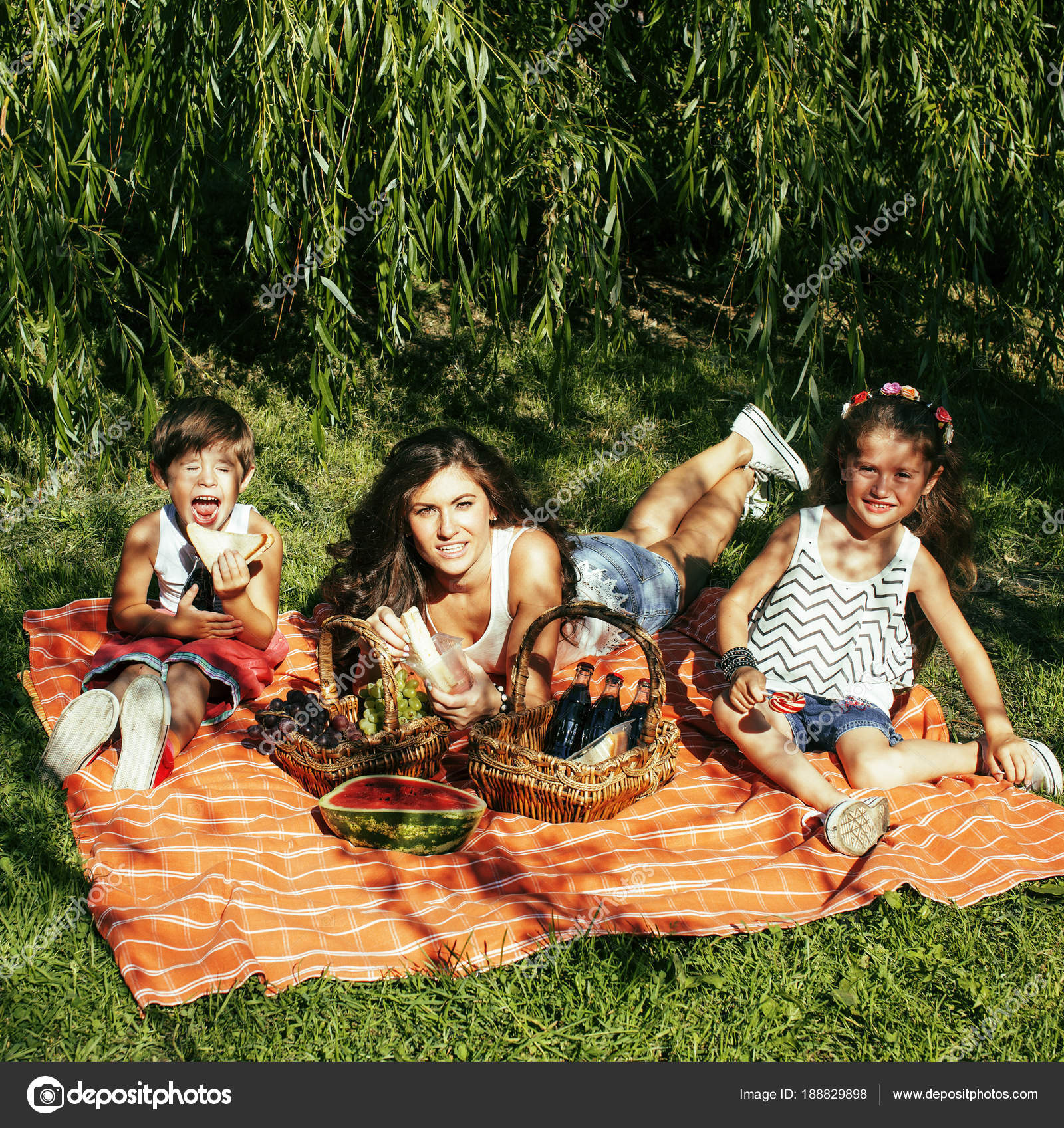 cute happy family on picnic laying on green grass mother and kid ...