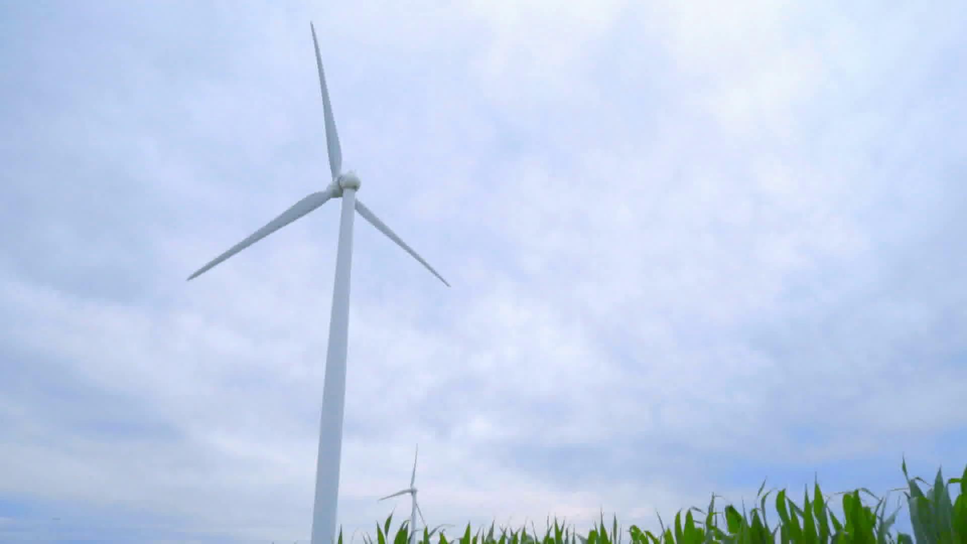 Wind power generator against cloudy sky. Wind turbine against sky ...