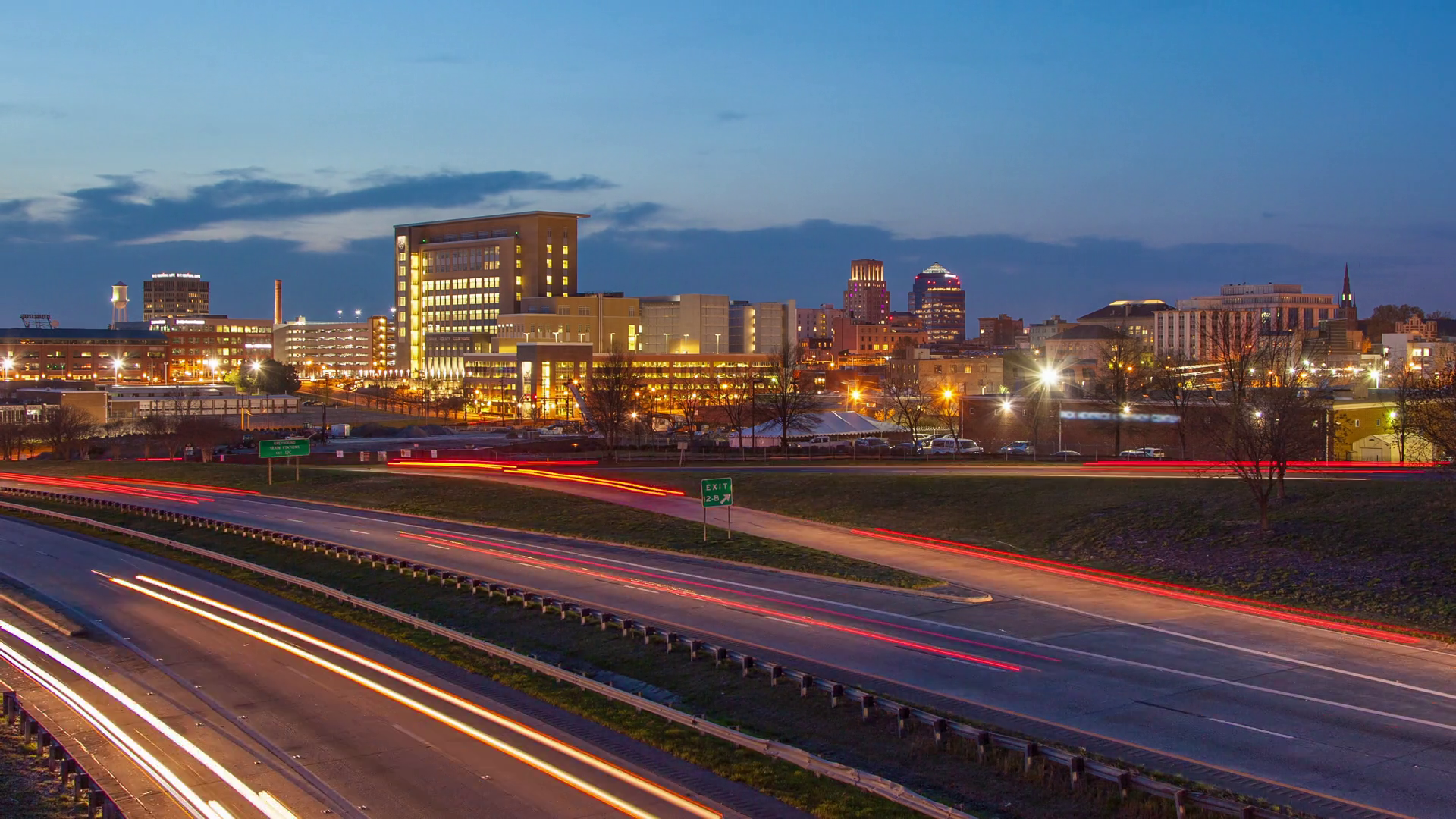 Durham NC City Skyline Timelapse with Fast Moving Interstate Vehicle ...
