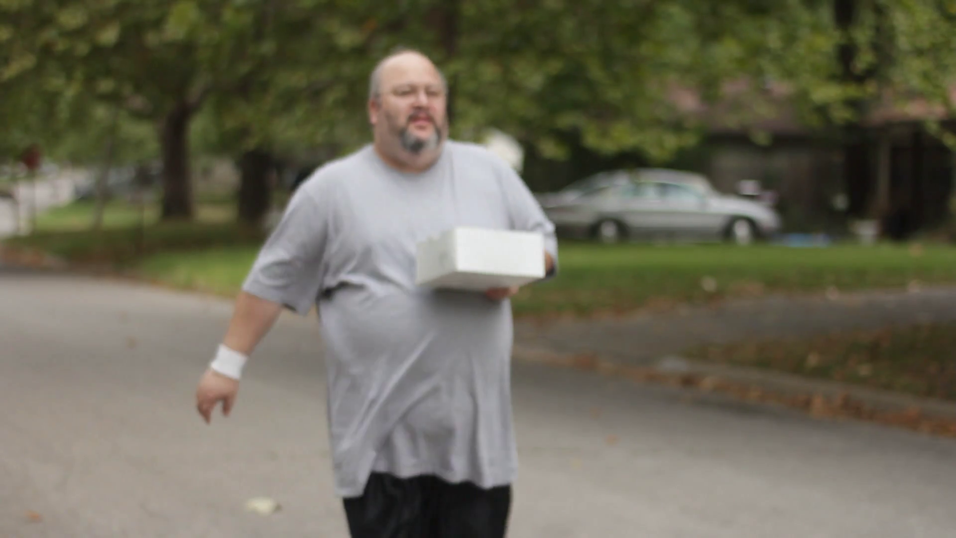 Fat Guy Walking with Donuts Stock Video Footage - Videoblocks