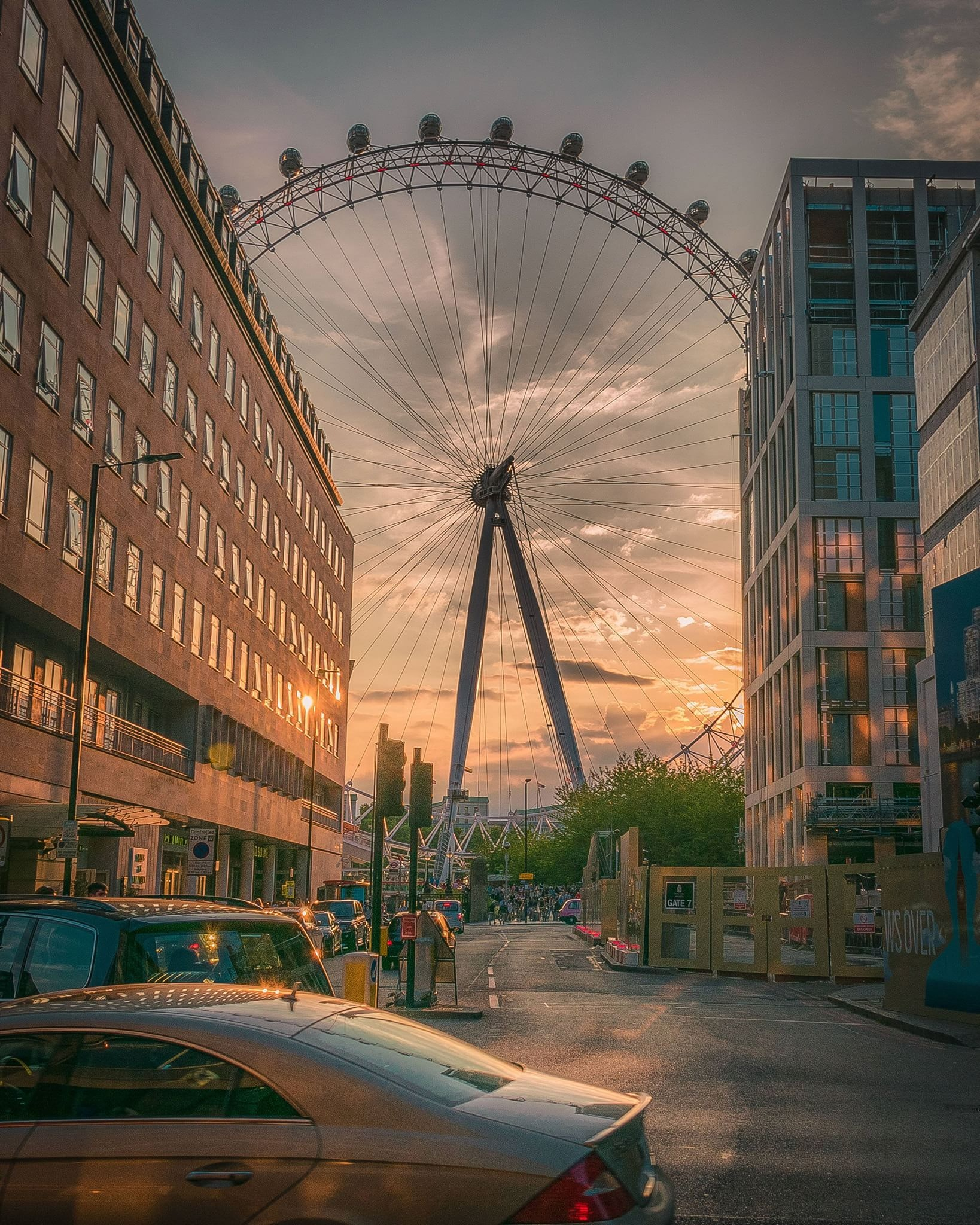 Ferris wheel near building during sunset photo