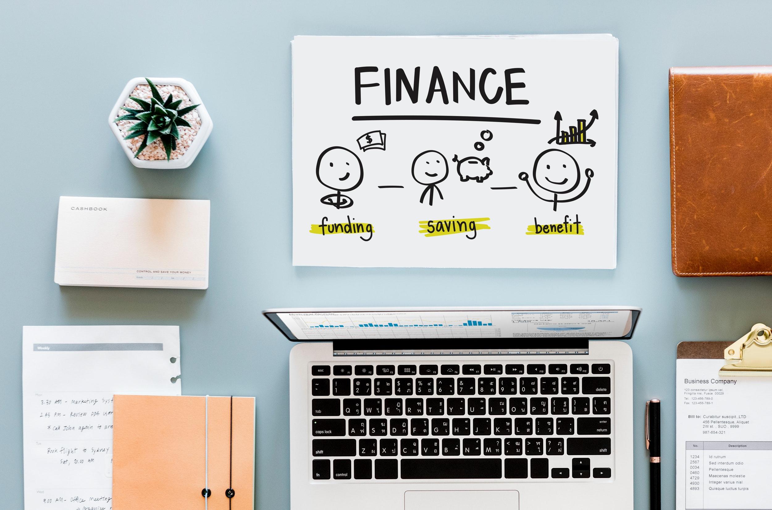 Finance sketch near laptop computer photo