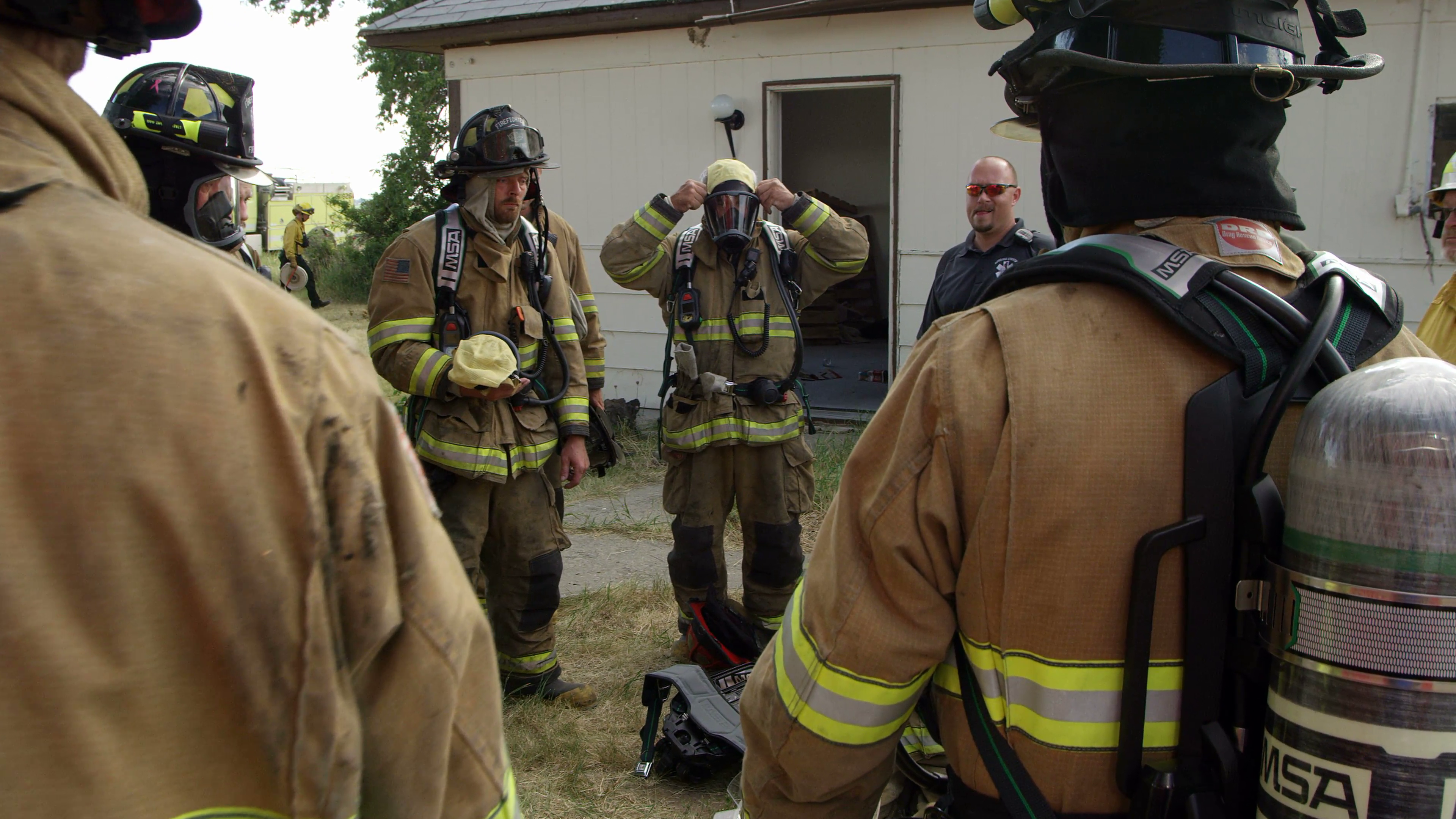 Firemen in a huddle as they prepare for training Stock Video Footage ...