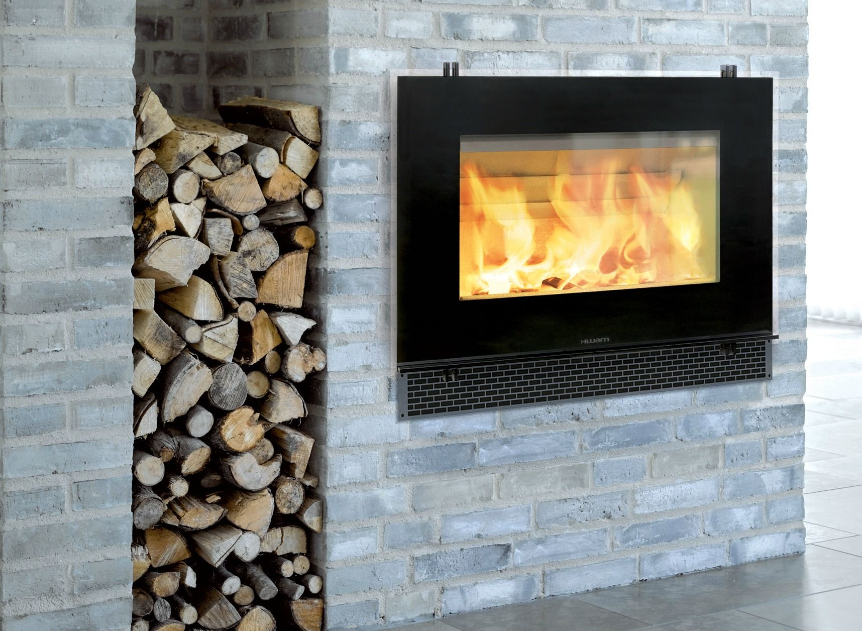 contemporary wood burning fireplace designs with gray brick wall ...