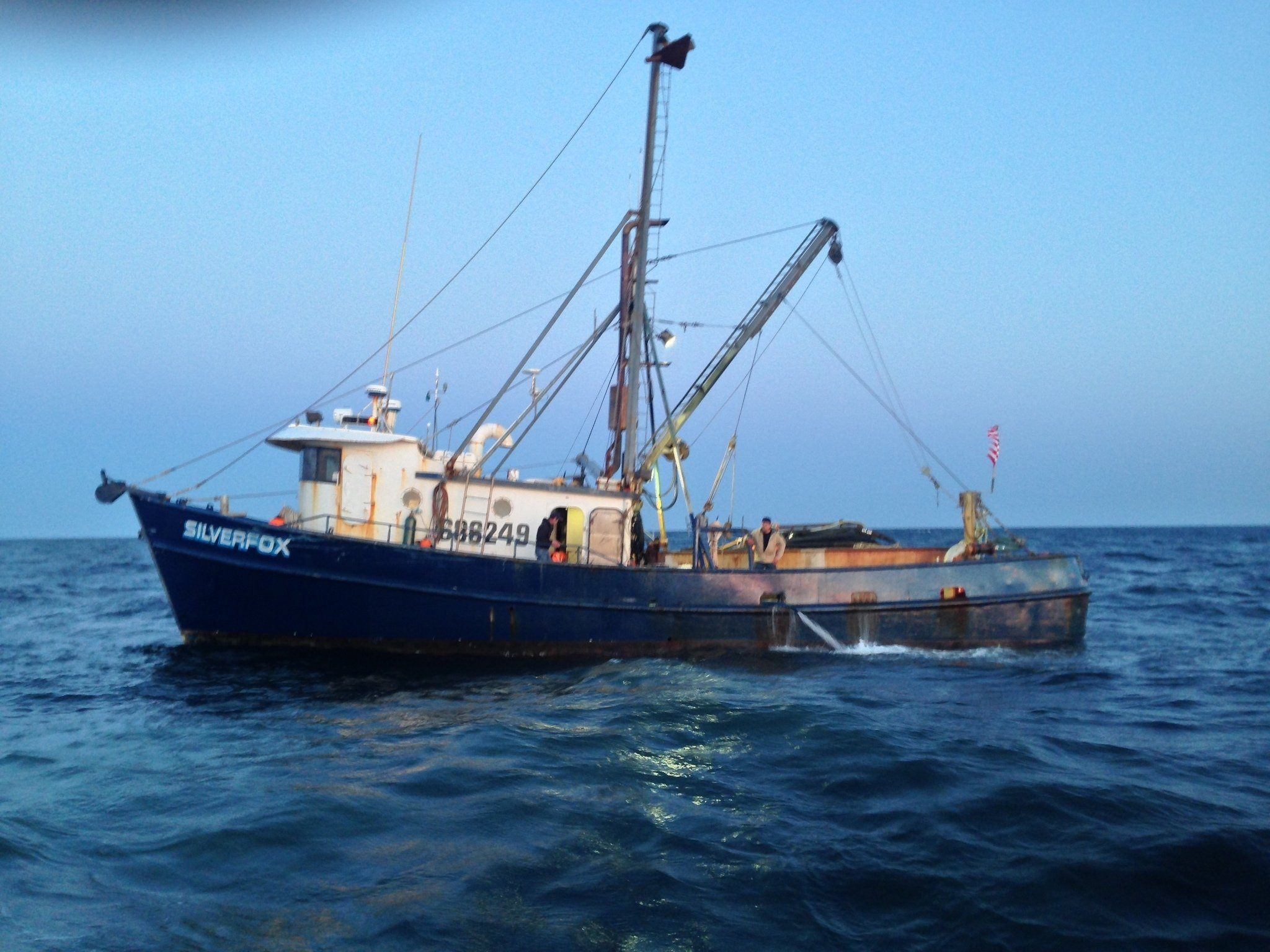 Coast Guard rescues crews from 2 sinking fishing boats off ...